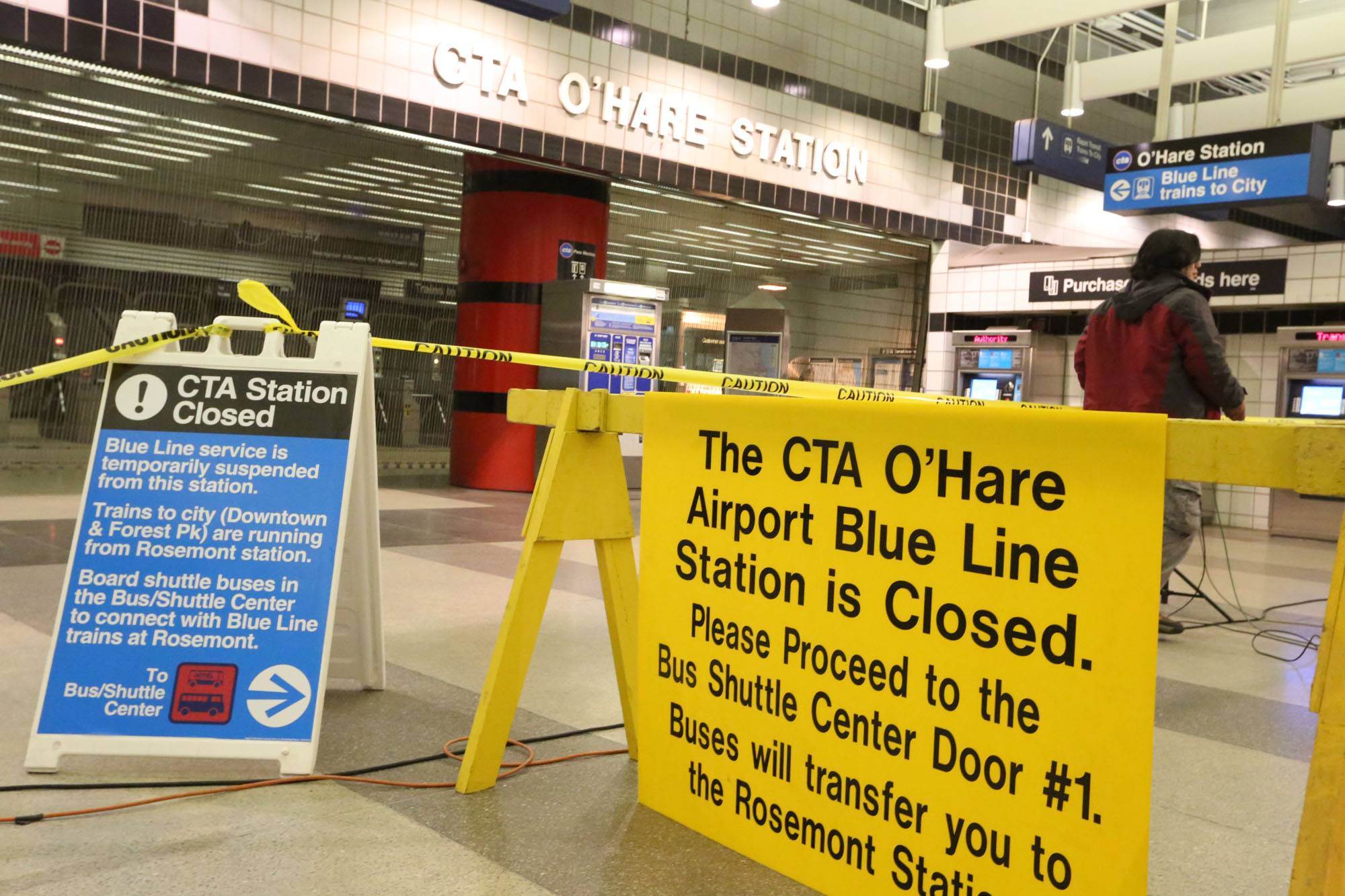 George LeClaire/gleclaire@dailyherald.com Signs in front of the O'Hare CTA station direct riders to take shuttle buses. Work continues at the site of Monday's Blue Line crash and officials anticipate reopening the station some time this weekend.