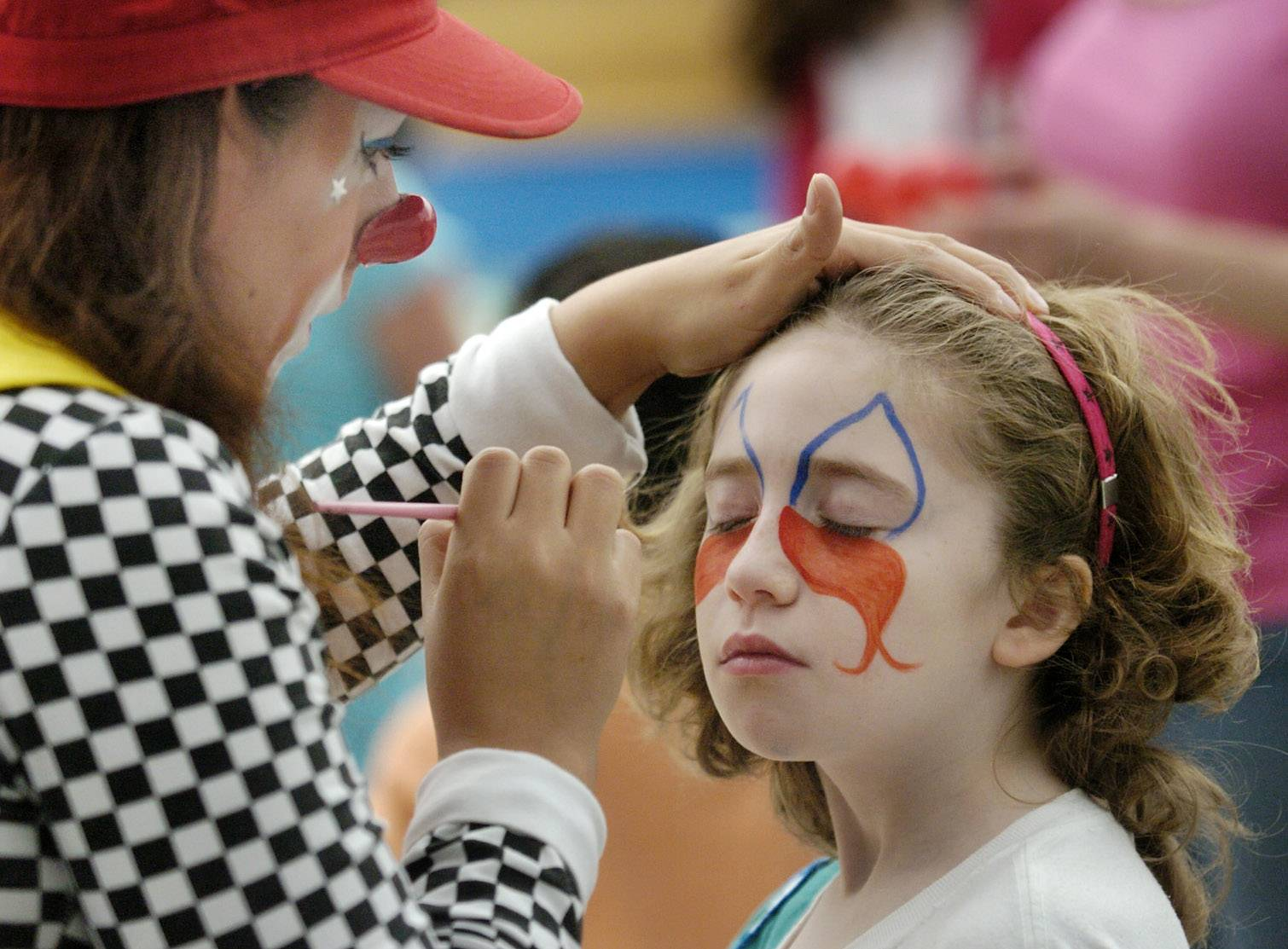 Alia Bongiorno gets her face painted by Ruth Flores during the Hanover Park Kids at Hope Community Resource Fair held two years ago. The event returns Saturday.