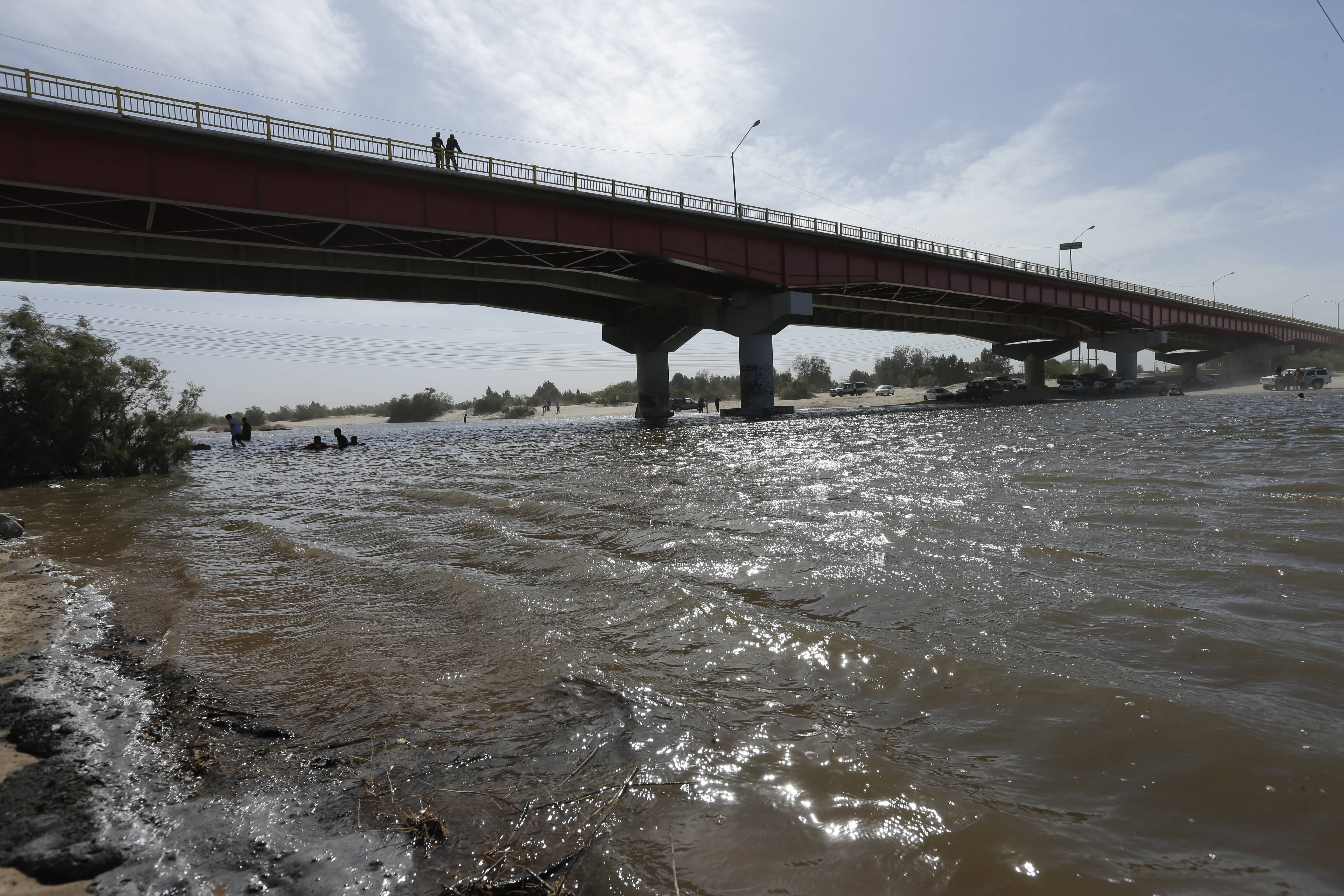 Water flows in a usually dry riverbed Wednesday in San Luis Rio Colorado, Mexico. Colorado River water has begun pouring over a barren delta near the U.S.-Mexico border, the result of a landmark bi-national agreement being celebrated Thursday.