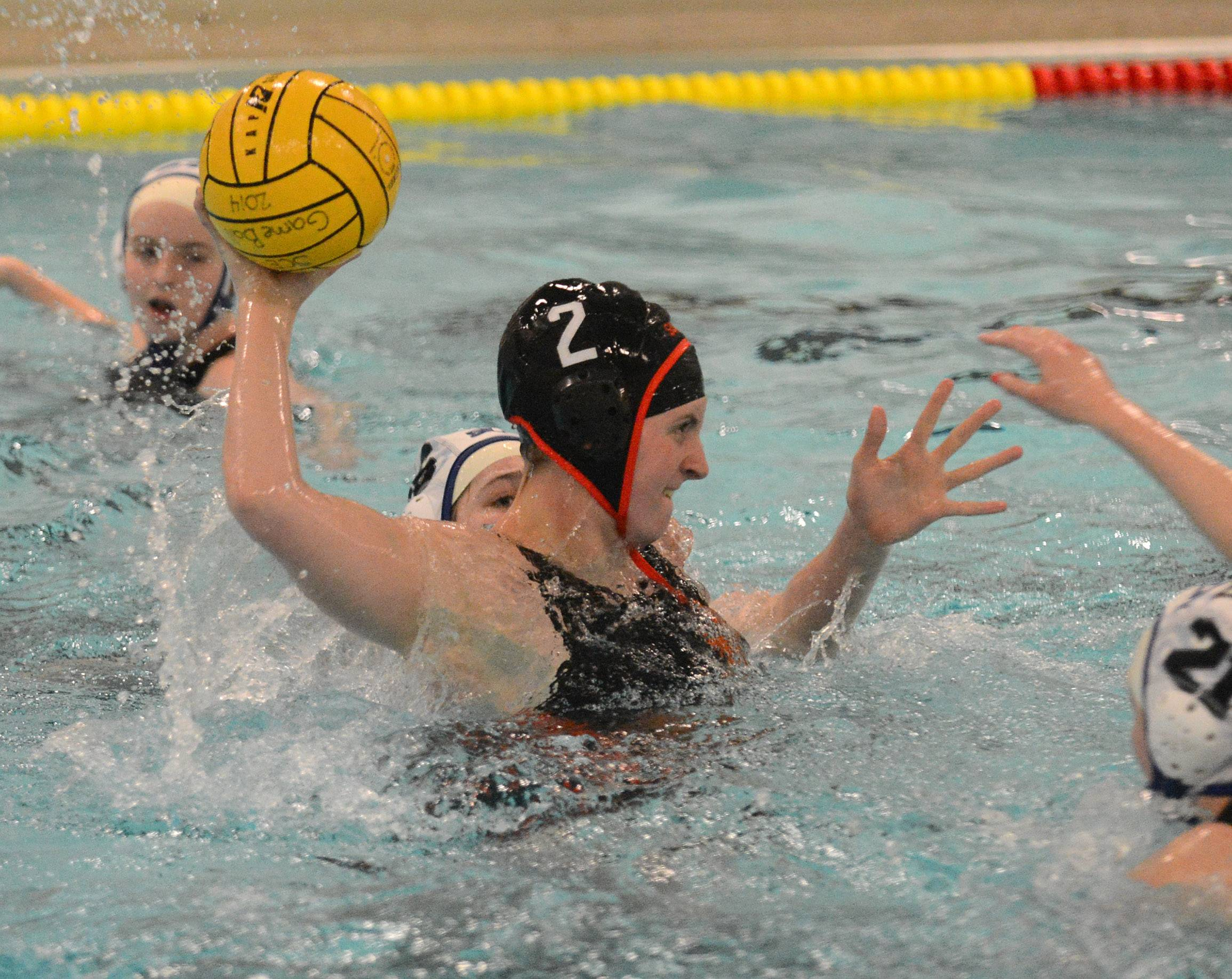 St. Charles East's Alexandra Kos shoots and scores the Saints second goal against St. Charles North during water polo action at St. Charles East Thursday.