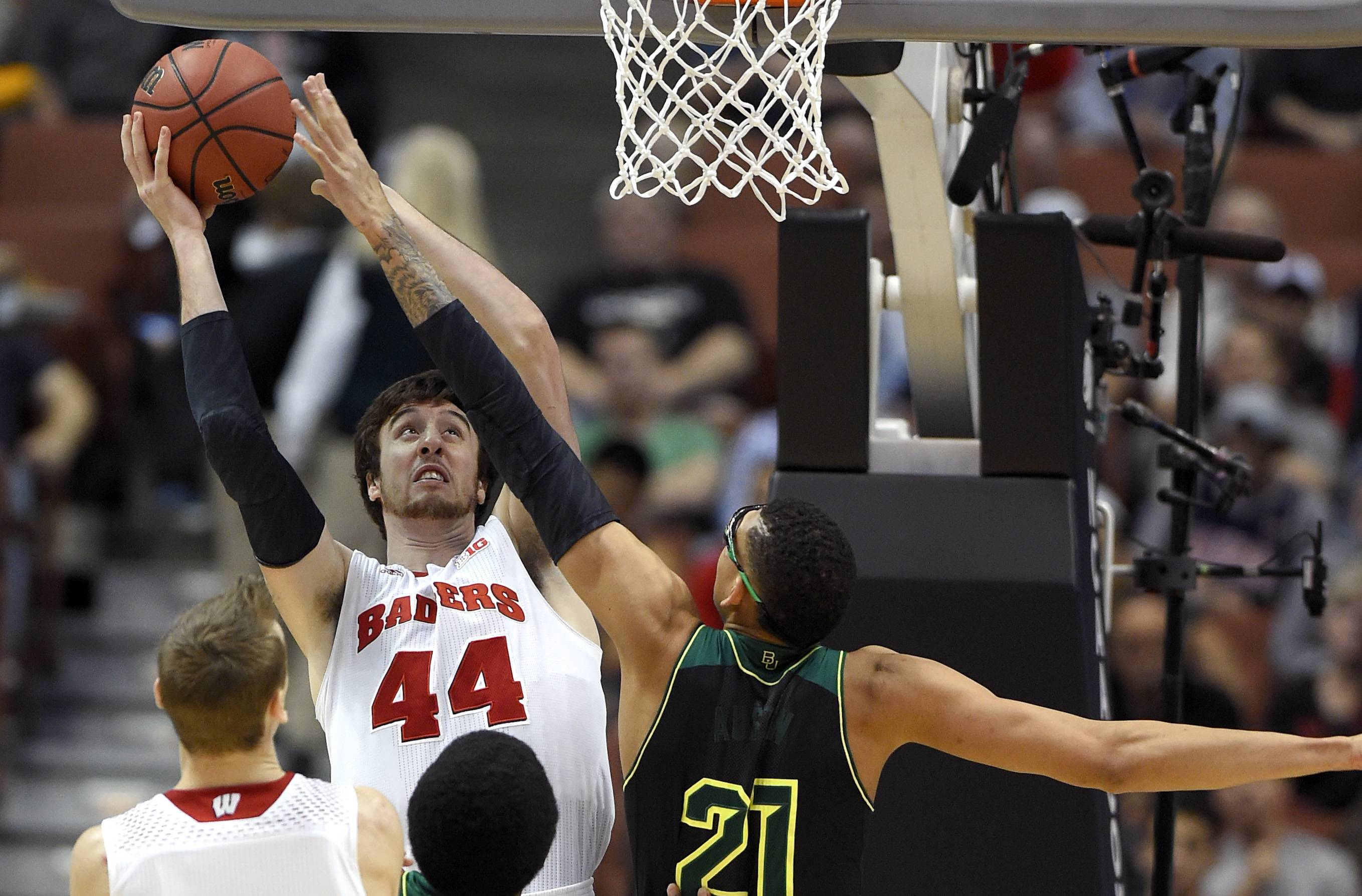 Wisconsin forward Frank Kaminsky (44) shoots over Baylor center Isaiah Austin (21) during an NCAA men's college basketball tournament regional semifinal, Thursday, March 27, 2014, in Anaheim, Calif.