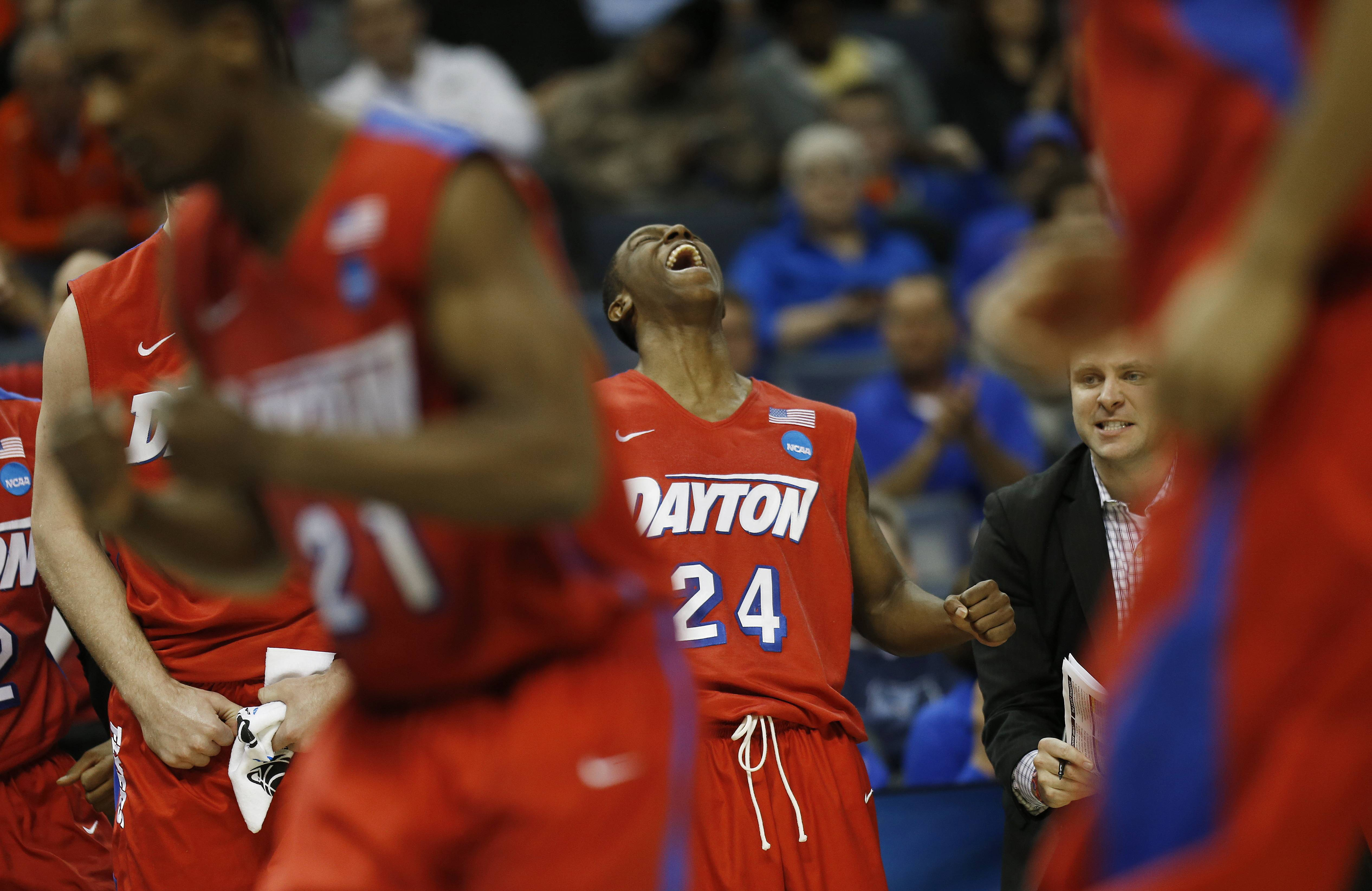 Dayton guard Jordan Sibert (24) celebrates a three-point shot against Stanford during the second half in a regional semifinal game at the NCAA college basketball tournament, Thursday, March 27, 2014, in Memphis, Tenn. Dayton won 82-72.