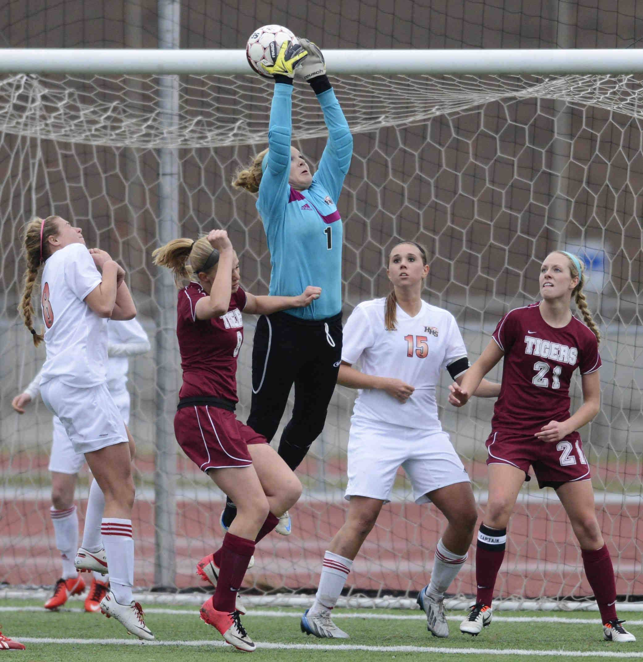 Huntley goalkeeper Jessica Galason leaps to make a save during a game last season.
