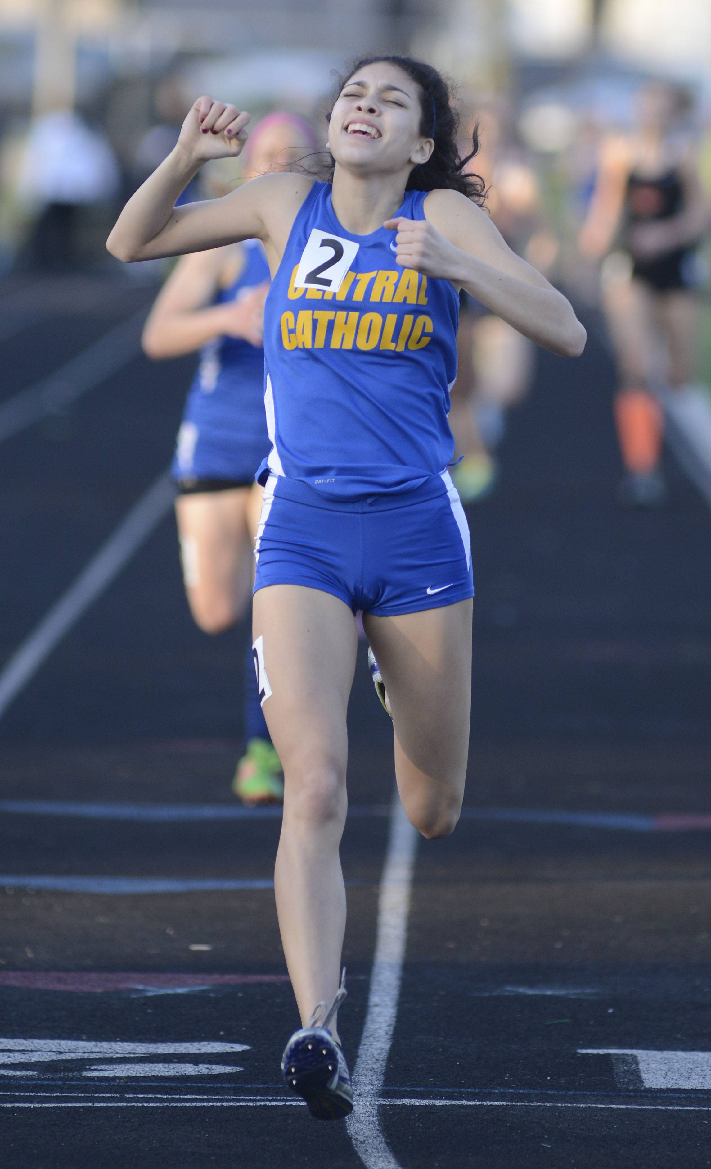 Aurora Central Catholic's Karina Liz takes first place in the final heat of the 800 meter run finals at the Kane County Invitational track in Geneva meet on Friday, April 26.