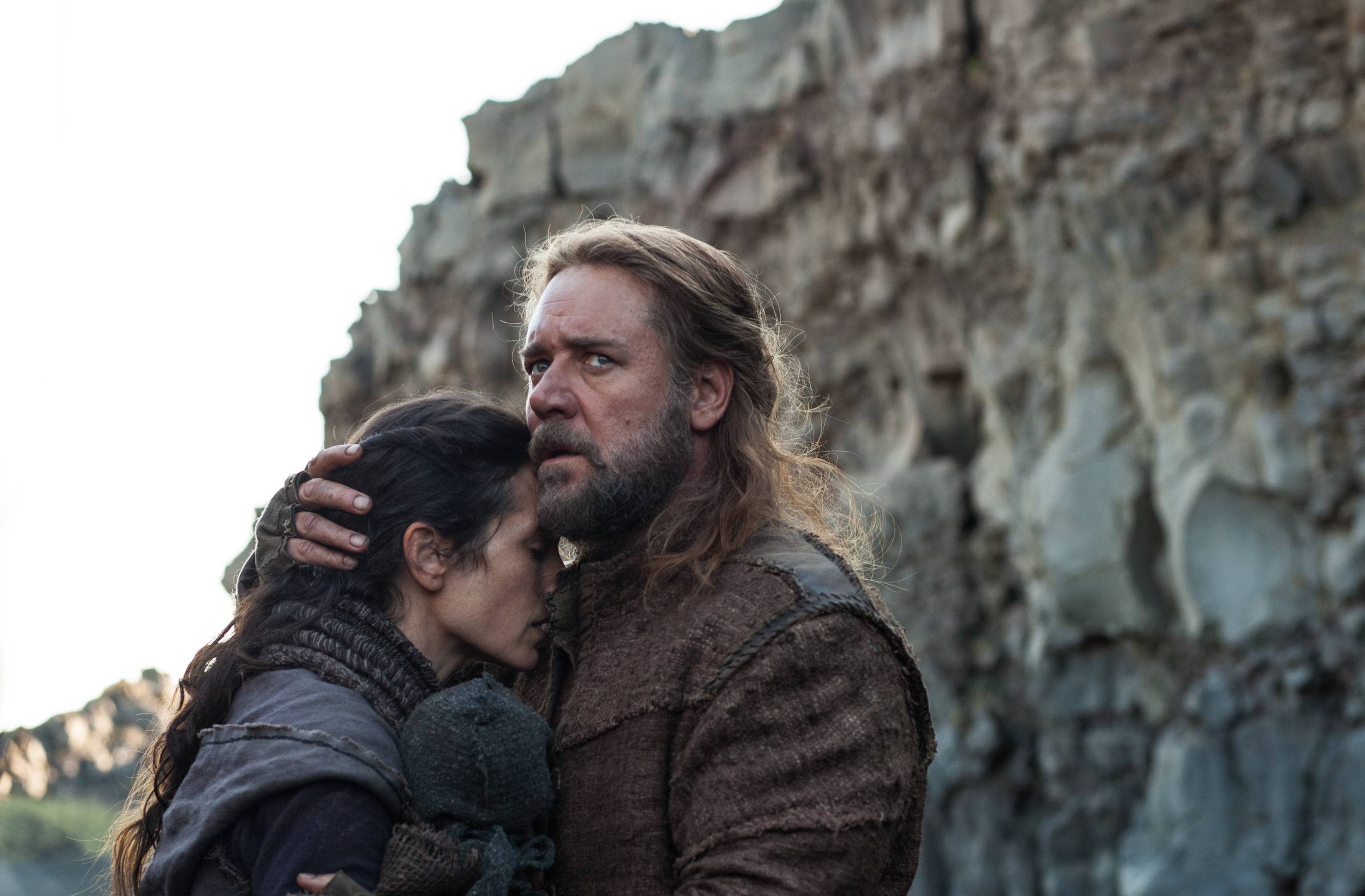 "Noah (Russell Crowe) comforts his wife Naameh (Jennifer Connelly) in Darren Aronofsky's take on the biblical tale of ""Noah."""