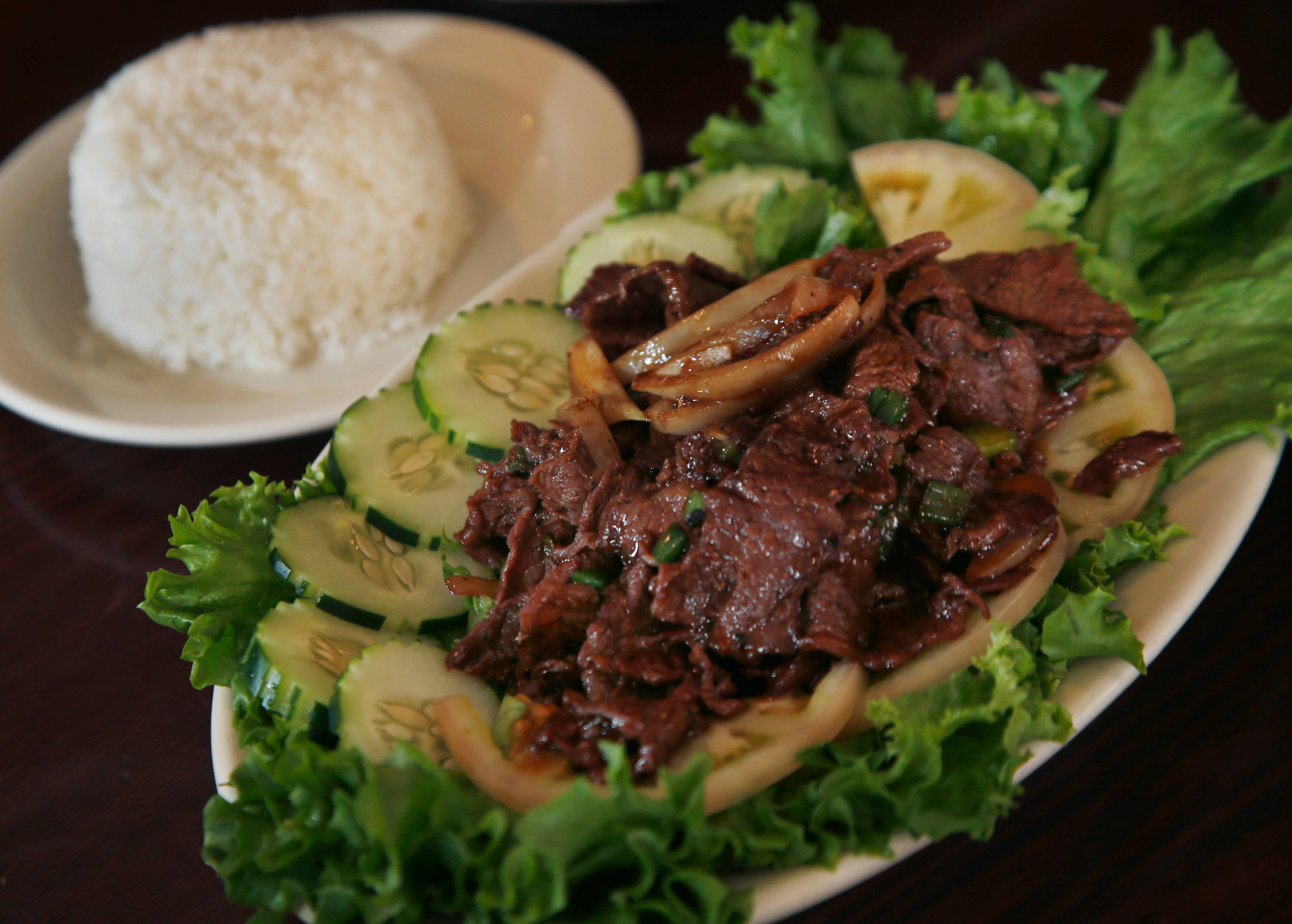 Try the beef loc lac at Simply Khmer, a Cambodian restaurant in Lowell, Mass. The classic Cambodian dish consists of seared beef that has been marinated and cooked in a savory sauce made with garlic, soy sauce, sugar and other ingredients.