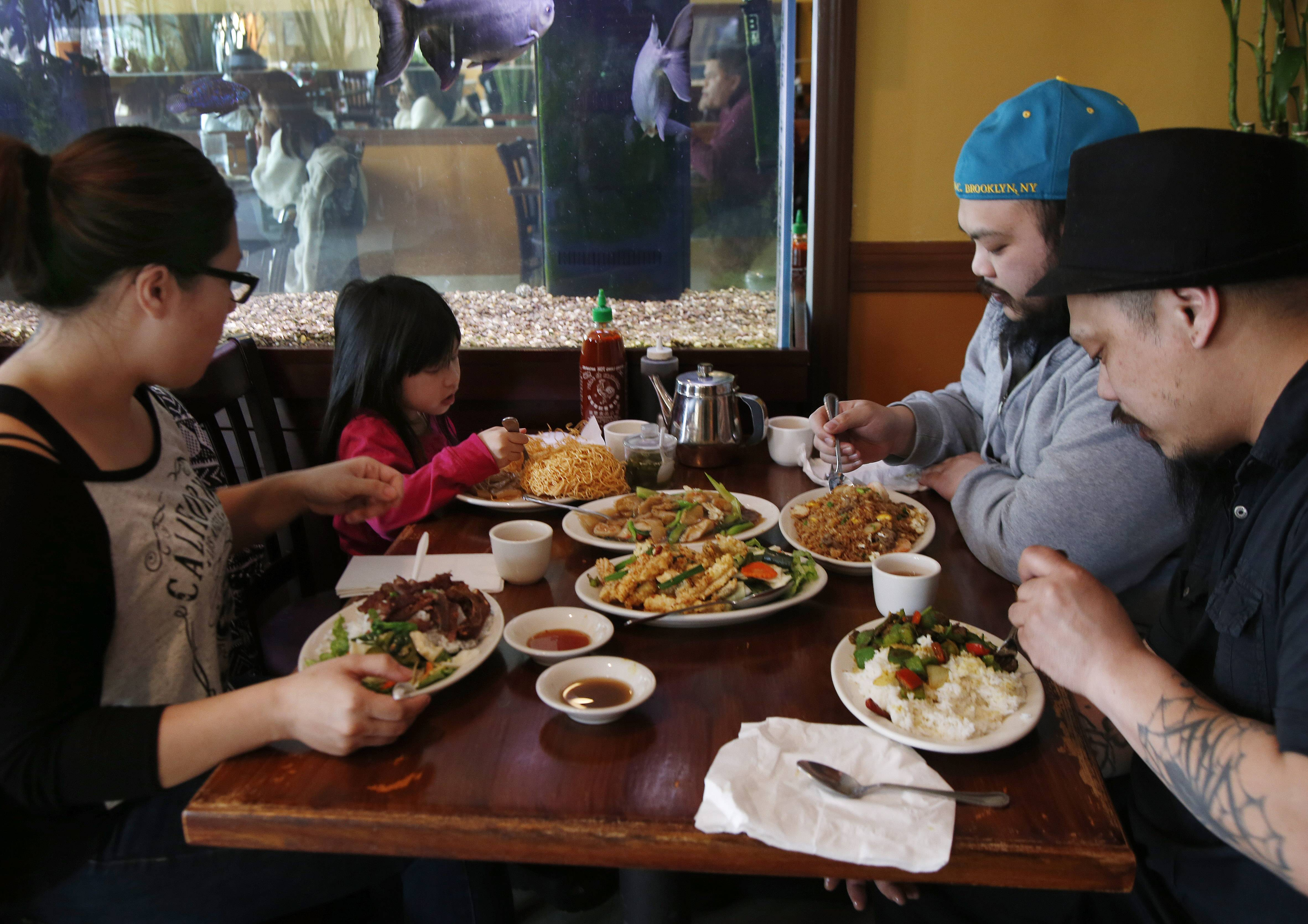 Patrons eat lunch at Simply Khmer, a Cambodian restaurant in Lowell, Mass.