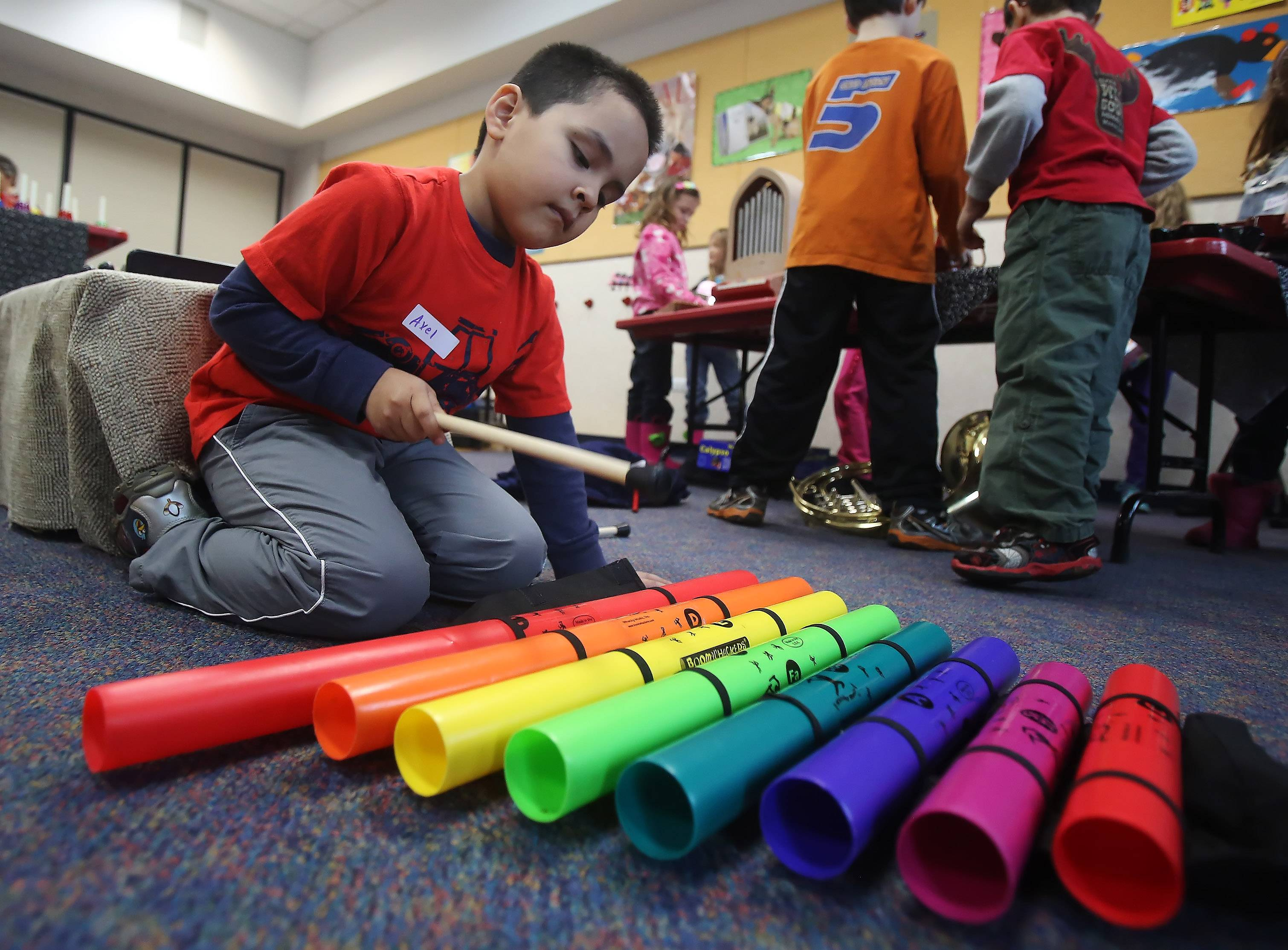 "Axel Medeana, 5, pounds on some tubes during ""Ms. Sue's Musical Petting Zoo!"" program Thursday at the Fremont Public Library in Mundelein. Children's music instructor Susan Nierman of Mundelein introduced young children to a variety of musical instruments."