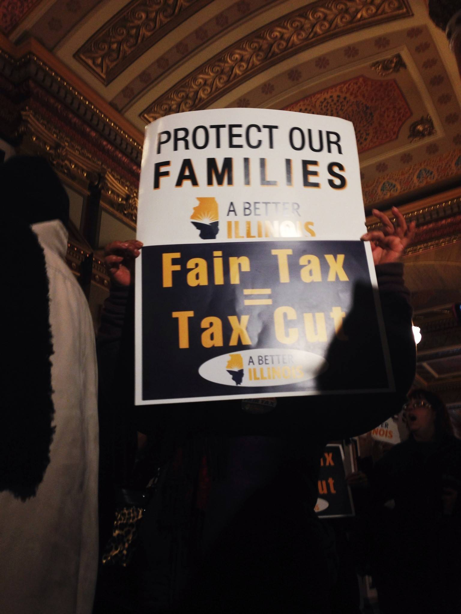Demonstrators at the Capitol Thursday asked lawmakers to consider a plan that would raise tax rates on people who have higher incomes.
