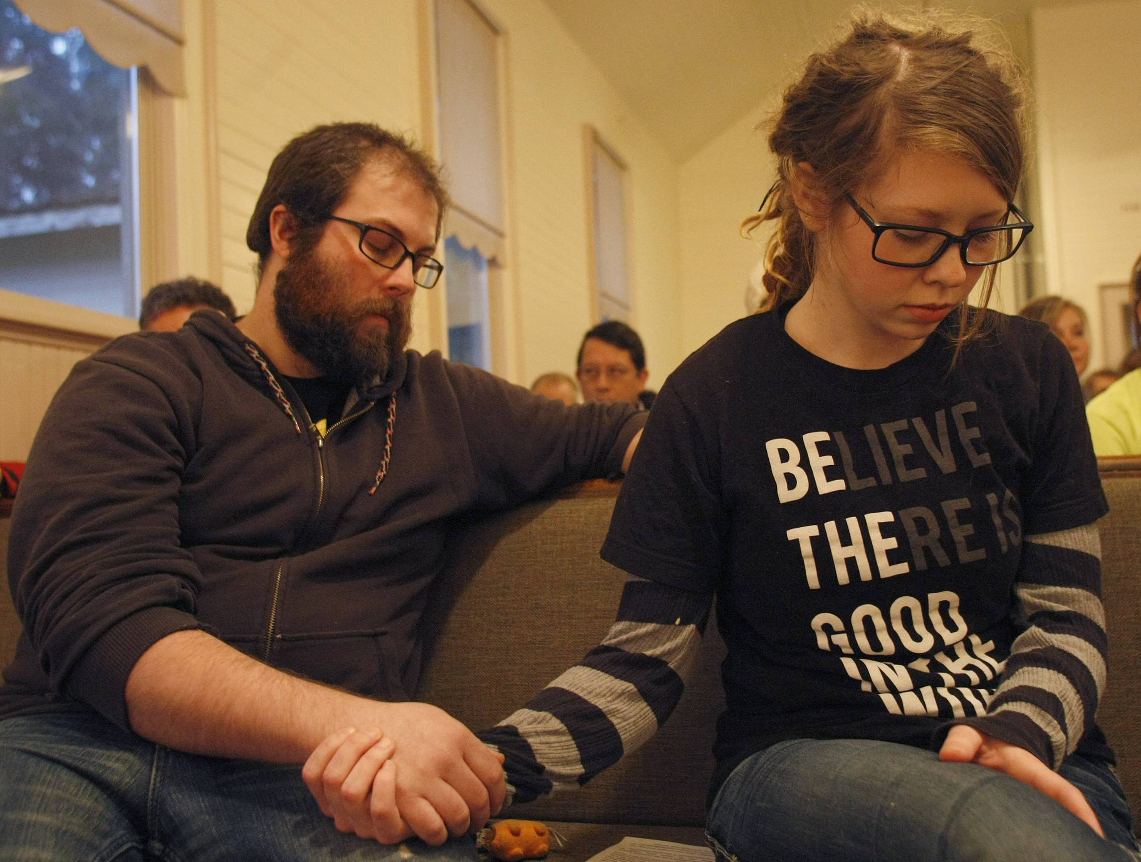 Community members Ryan and Molly Ray pray for mudslide victims at the Oso Community Chapel Wednesday in Oso, Wash.