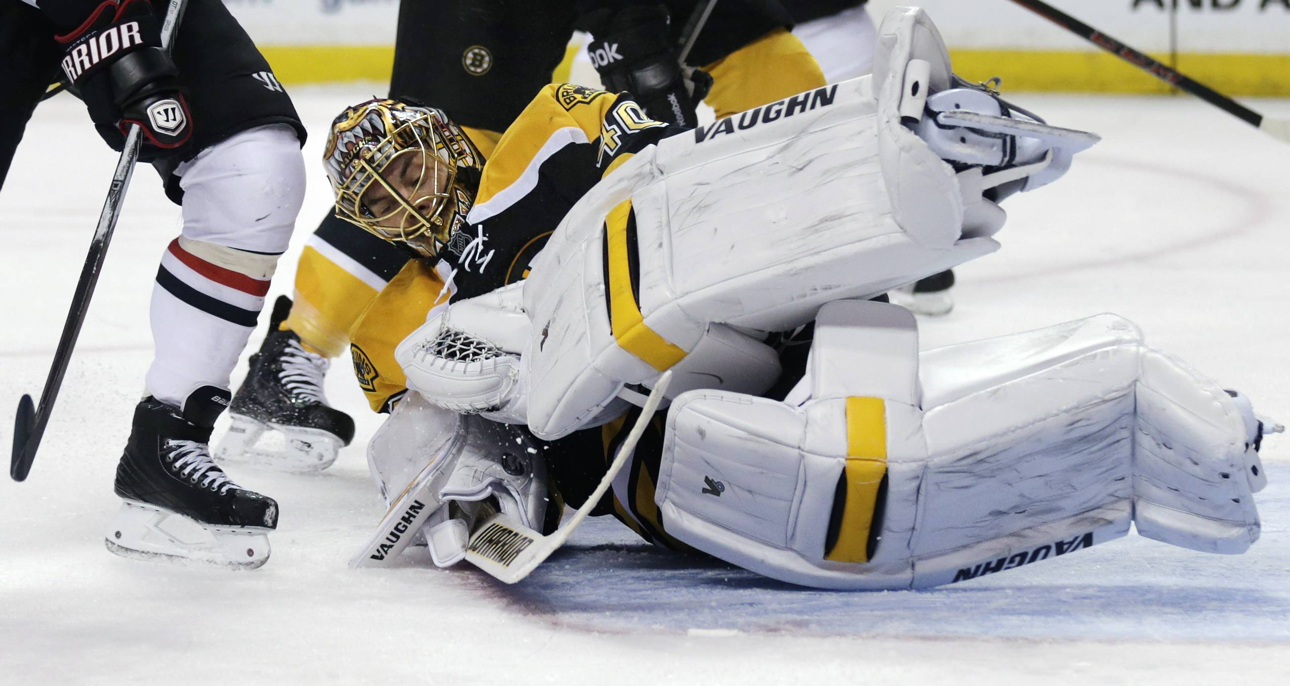 Tuukka Rask drops to the ice to make a save against the Blackhawks on Thursday night. The Bruins' goalie finished with 28 of them for his seventh shutout of the season