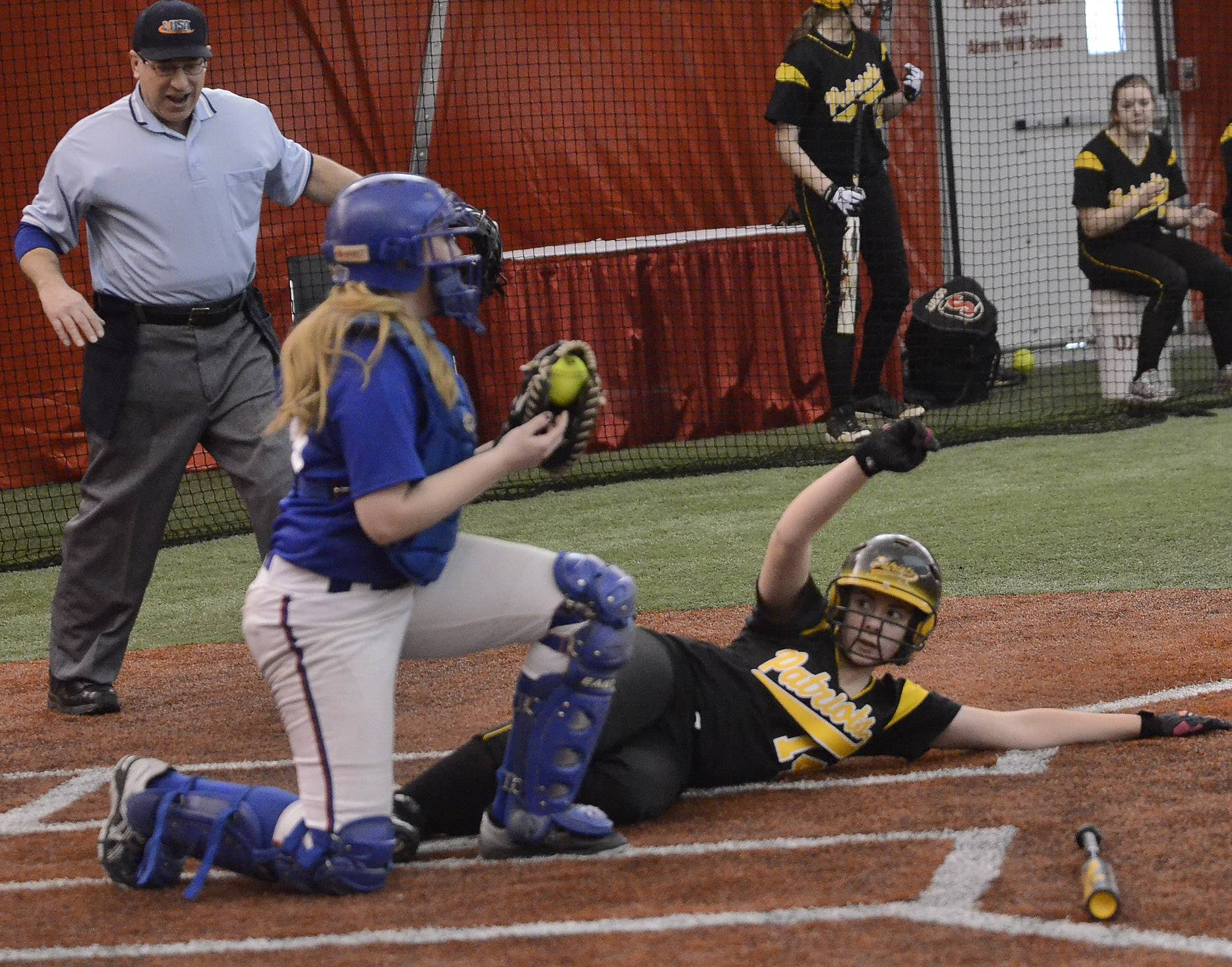 Stevenson's Molly Thon is safe at the plate in the fifth inning as she beats the tag by Lakes catcher Abbi Mehnert during action at The Dome in Rosemont on Thursday.