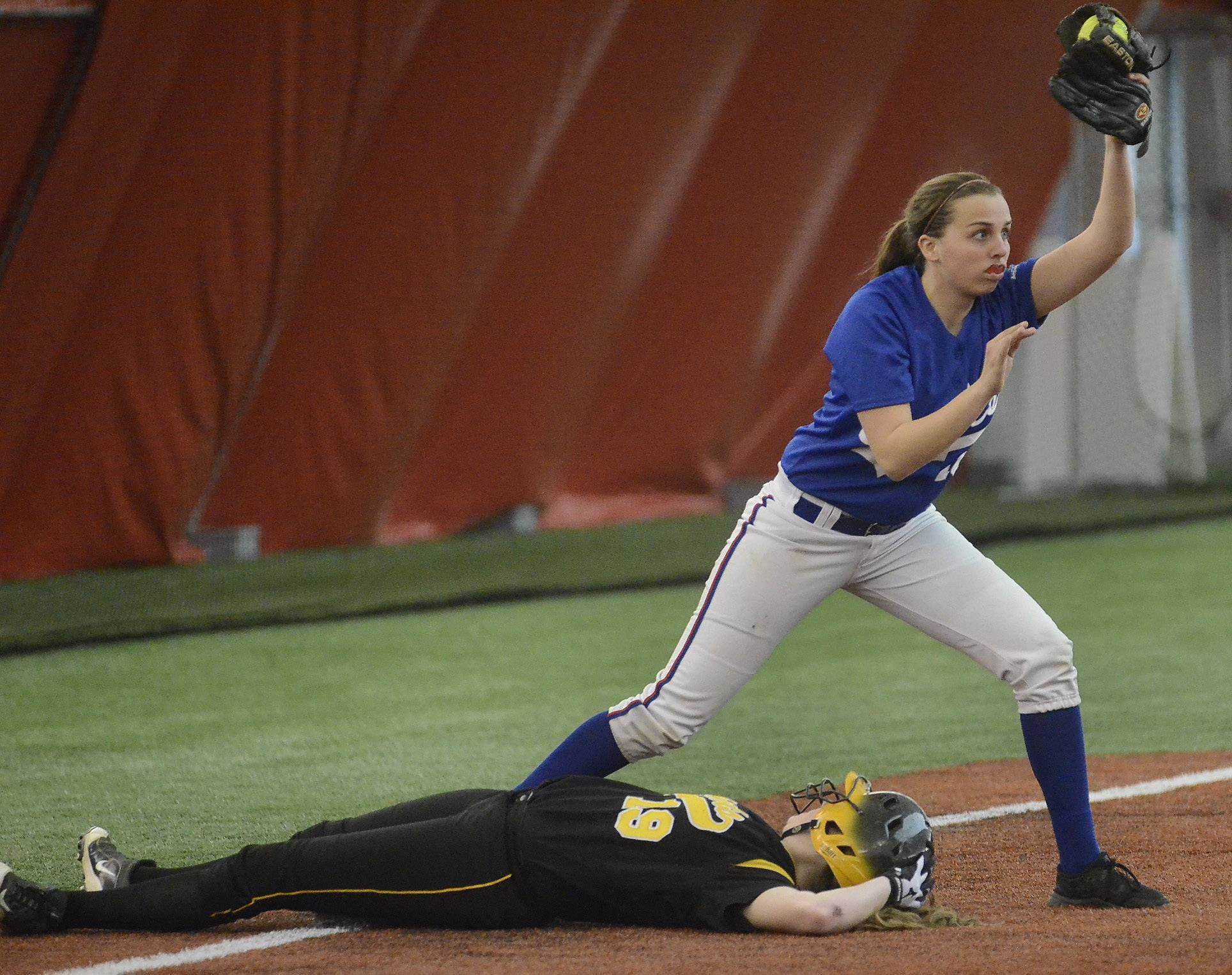 Stevenson's Dana Morgan is tagged out by Lakes third baseman Montana Mang to end the game, sealing the Eagles' 7-5 win at The Dome in Rosemont on Thursday.