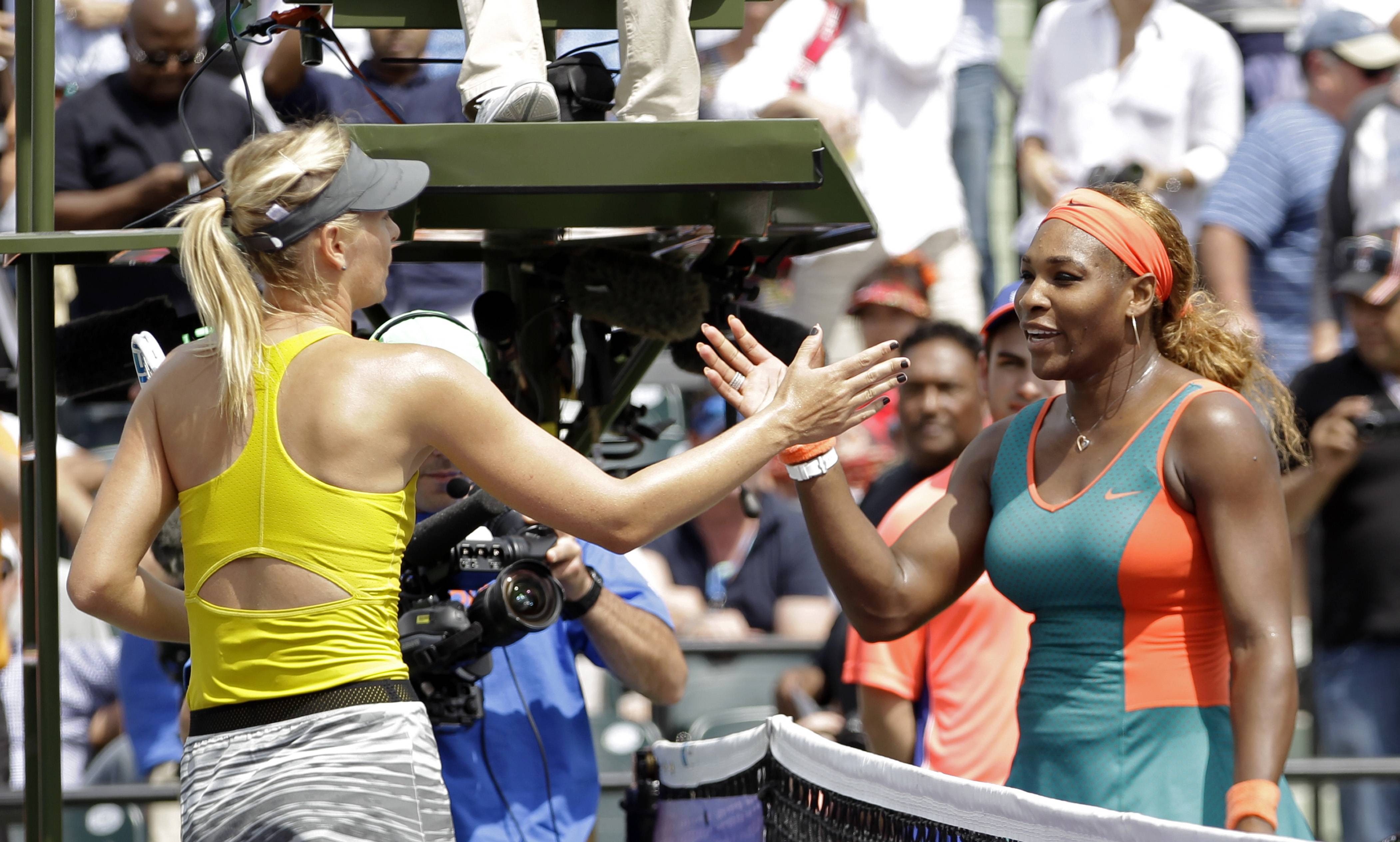 Maria Sharapova, of Russia, left, congratulates Serena Williams at the Sony Open tennis tournament in Key Biscayne, Fla., Thursday.