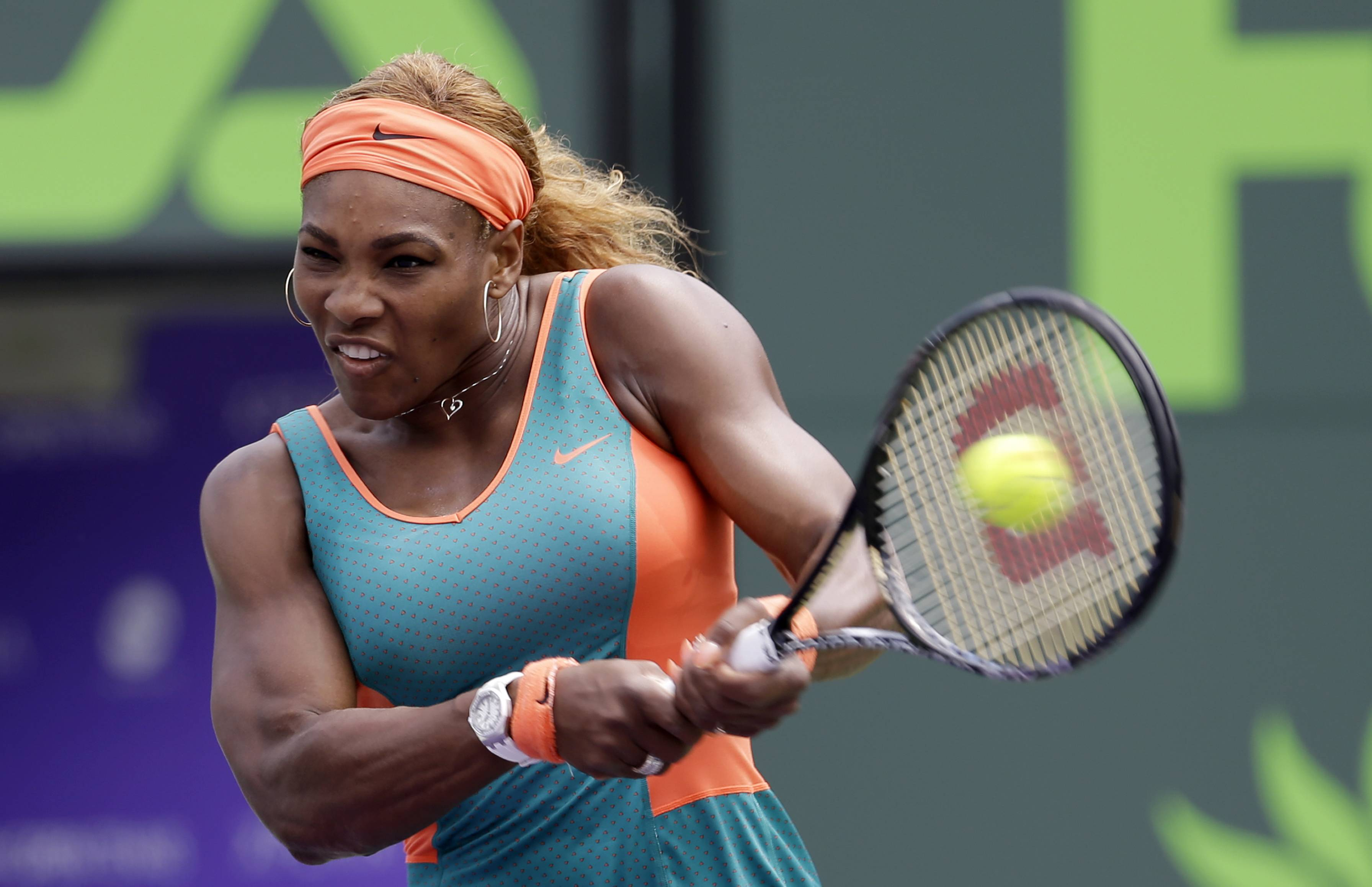 Serena Williams returns to Maria Sharapova, of Russia, at the Sony Open Tennis tournament in Key Biscayne, Fla., Thursday.