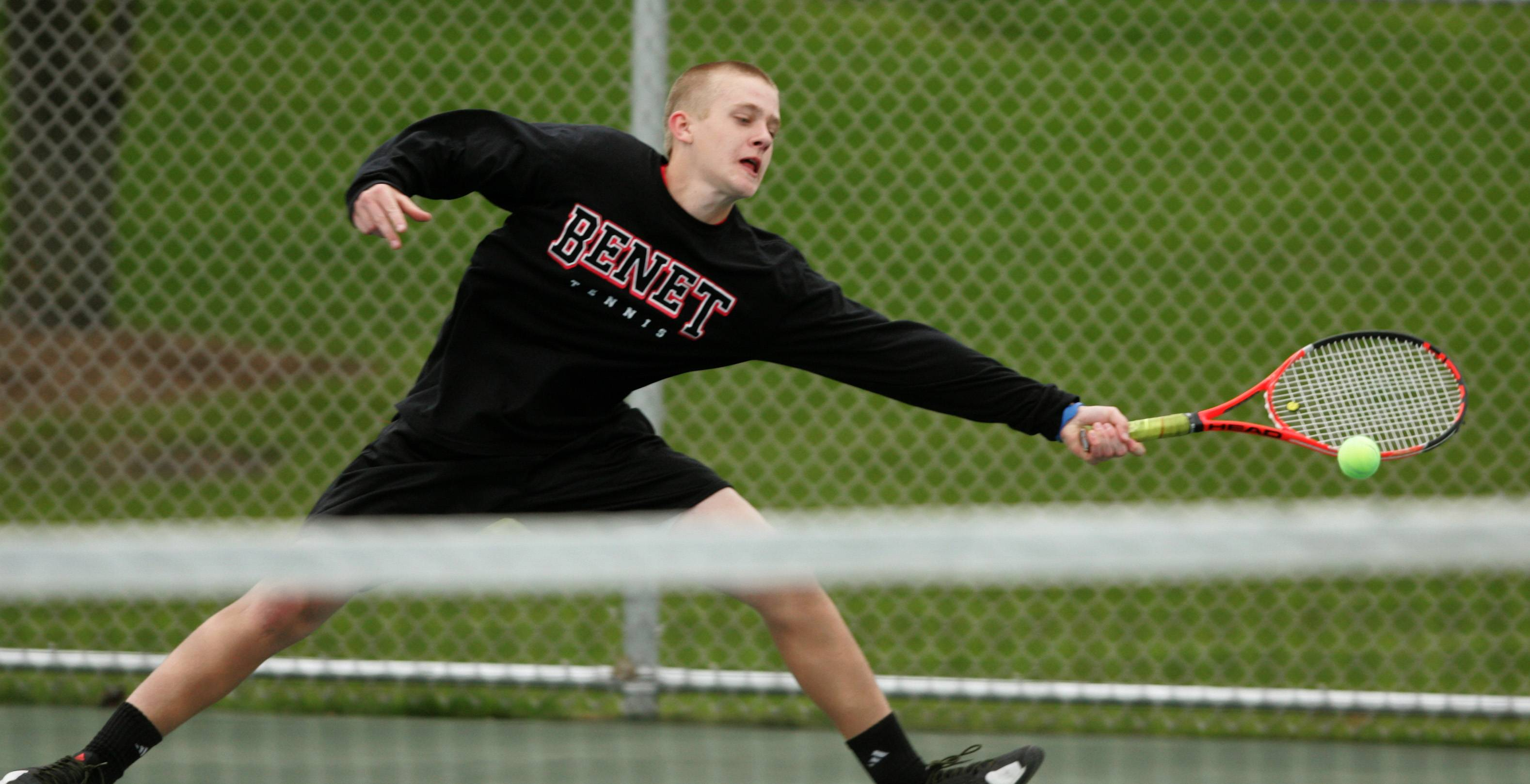 Daniel White/dwhite@dailyherald.com ¬ Number one singles player Noah Read of Benet Academy, returns a volley during the Naperville North Boys Tennis Invitational.