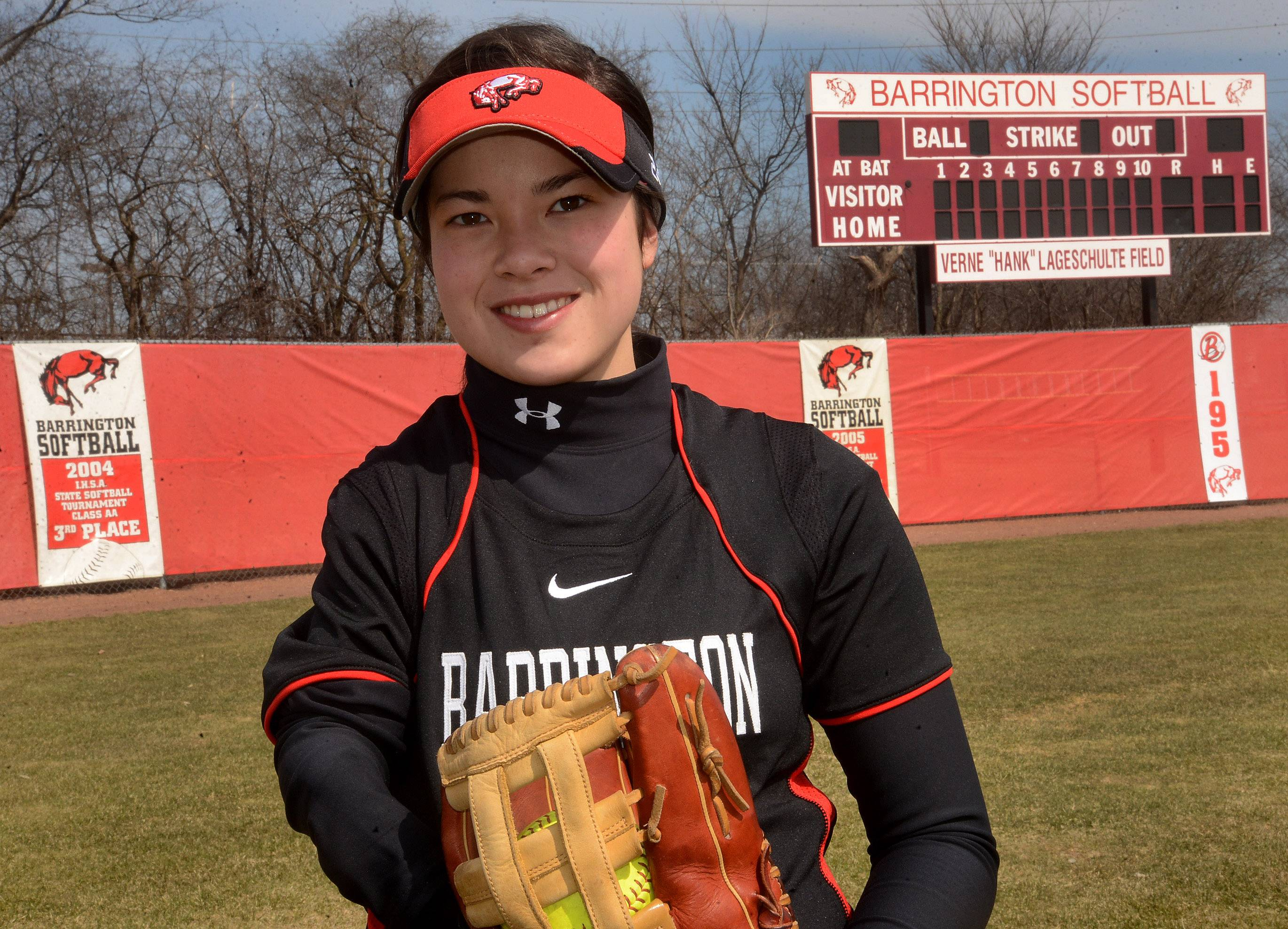 Barrington softball player Caitlin Inamoto succeeds using the Jim Abbott-style of catching the ball in the mitt, then taking the mitt off and throwing the ball with the same hand.