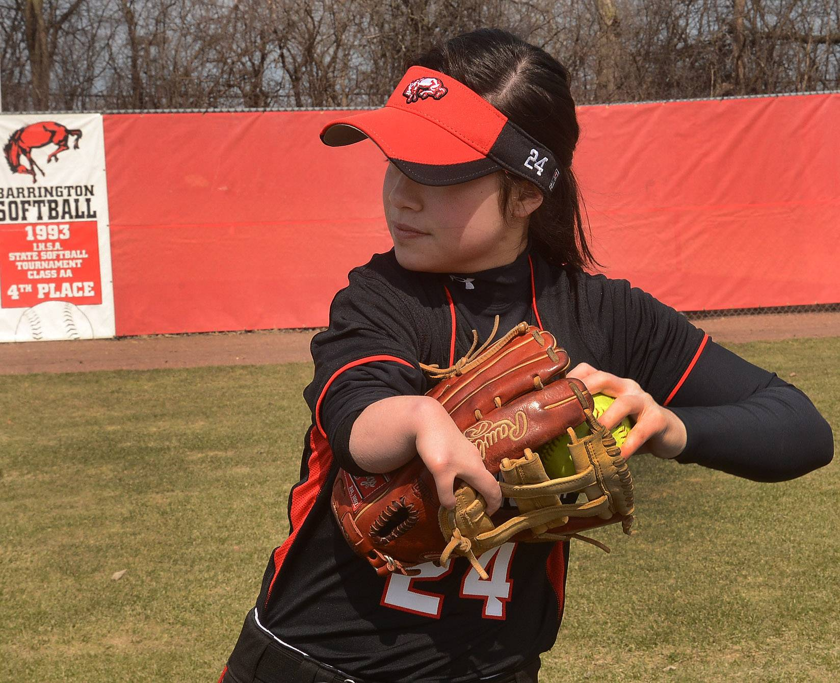 Barrington softball player Caitlin Inamoto has learned to excel using the Jim Abbott-style catching the ball in the mitt, then taking the mitt off and throwing the ball with the same hand.