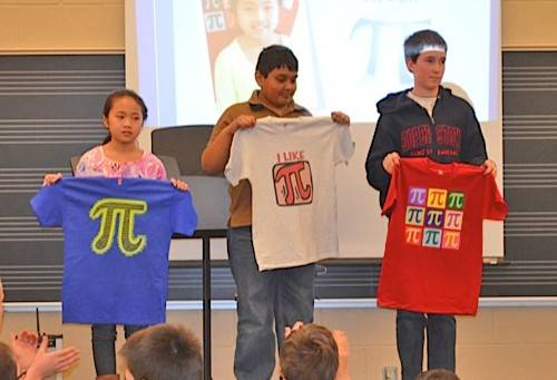 Michelle Wang, Yash Shah and Michael Daanen are the first-, second- and third-place winners, respectively, of the Pi Day challenge at Mill Creek Elementary School.