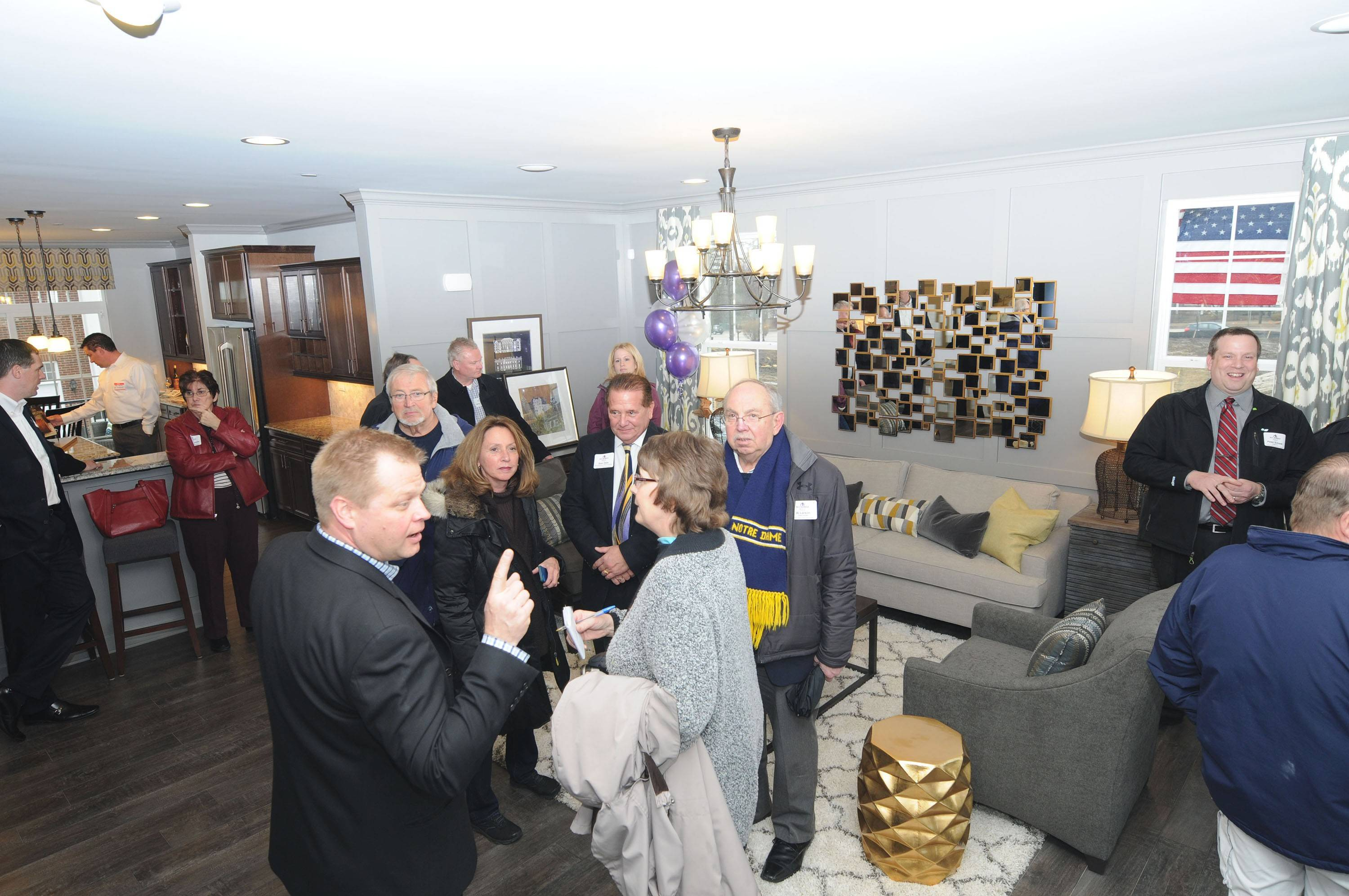 Schaumburg officials take a tour of the model during the ceremonial opening of the new Pleasant Square subdivision at the northwest corner of Schaumburg and Roselle roads Thursday afternoon.