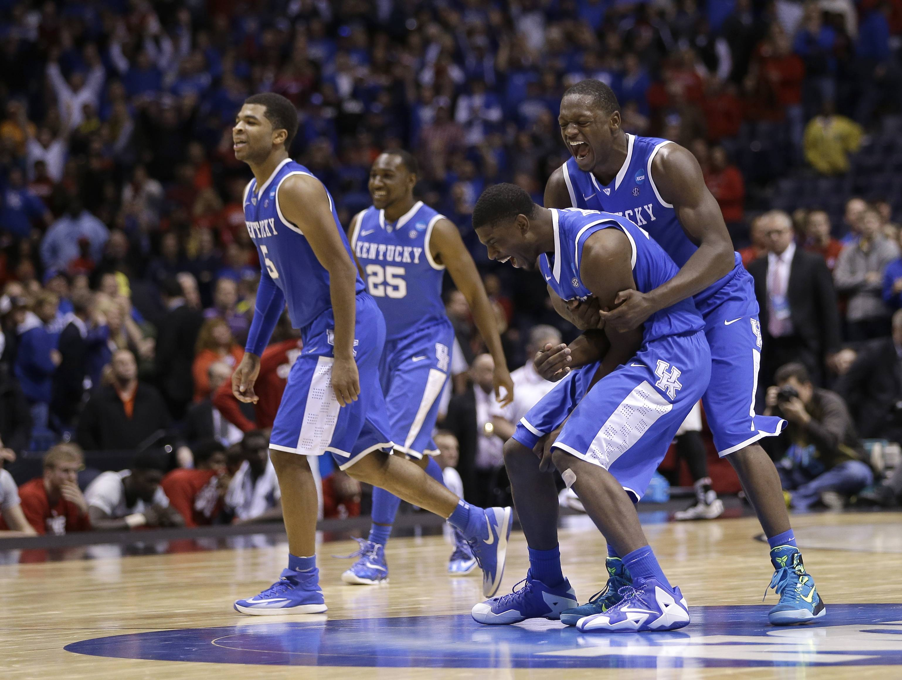 Kentucky's Alex Poythress and Aaron Harrison, right, celebrate after they beat Louisville Saturday in Indianapolis, 74-69.