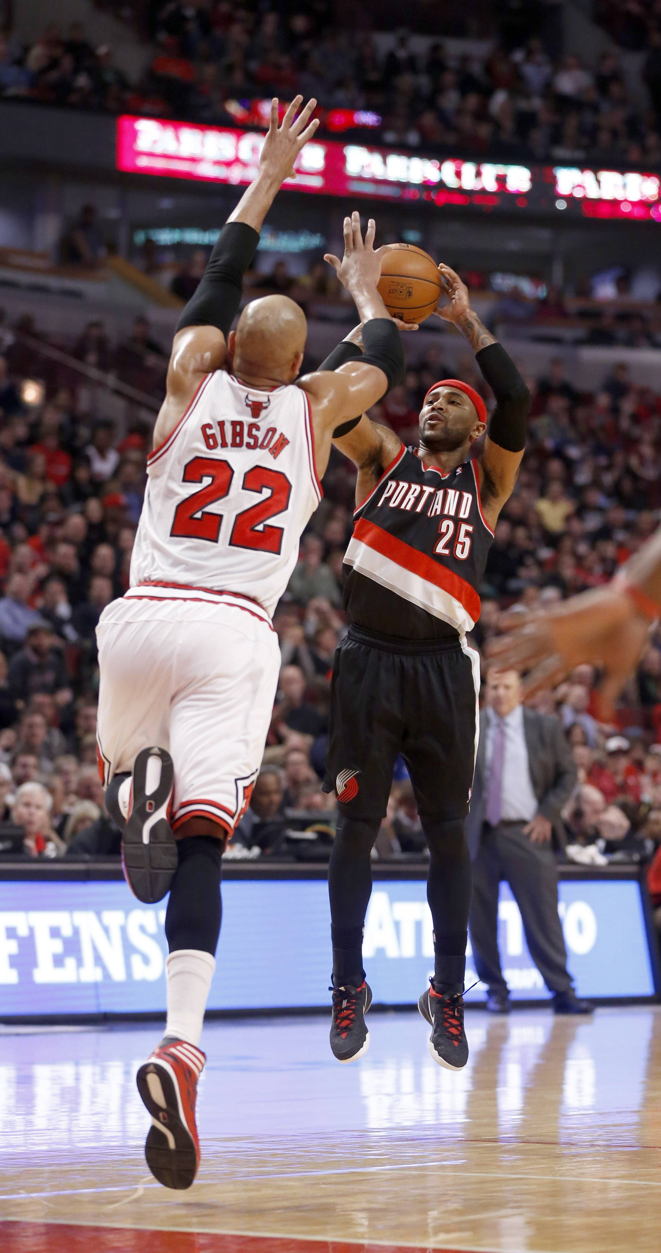 Trail Blazers guard Mo Williams fires up a jump shot as the Bulls' Taj Gibson leaps on defense Friday during action at the United Center.