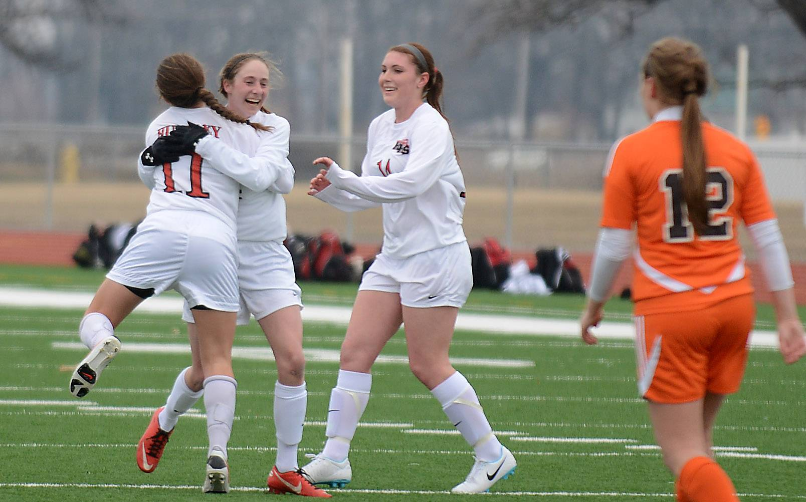 Huntley's Taryn Jakubowski (11) jumps into the arms of teammate Katie Costantino after scoring on long strike in the first half against Hersey during Friday's game in Huntley.