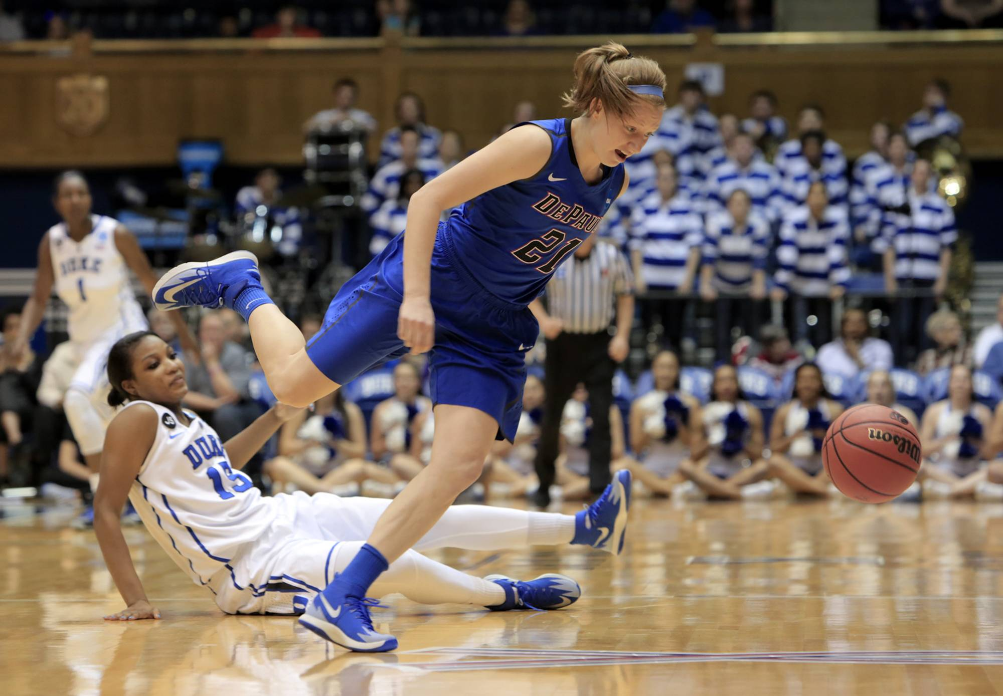DePaul's Megan Rogowski, game-high scorer with 22 points, beats Duke's Richa Jackson, on floor, to a loose ball during the second half of Duke's 74-65 loss in their second-round game in the NCAA basketball tournament in Durham, N.C., Monday, March 24, 2014. (AP Photo/Ted Richardson)