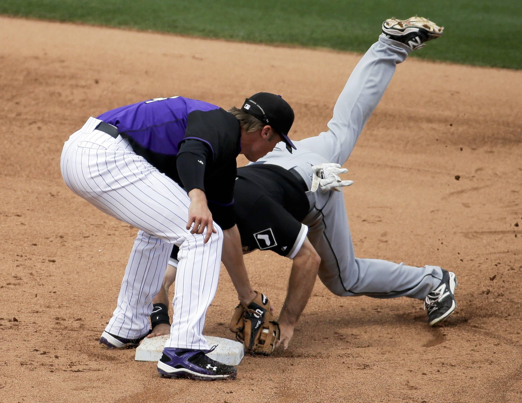 Chicago White Sox's Adam Eaton, right, is safe at second under the tag by Colorado Rockies shortstop Josh Rutledge during the sixth inning of a spring exhibition baseball game in Scottsdale, Ariz., Sunday, March 23, 2014. (AP Photo/Chris Carlson)
