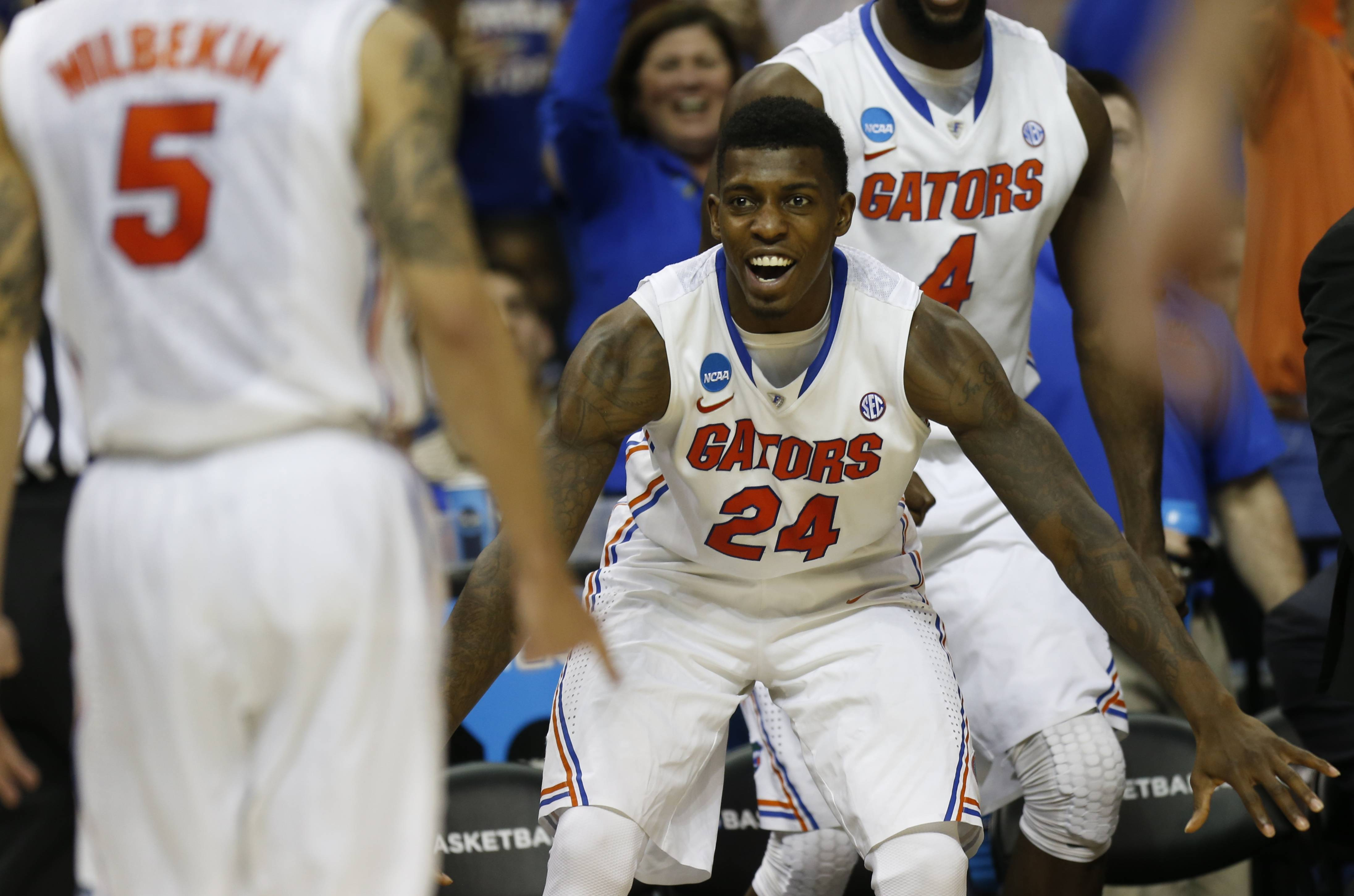 Florida forward Casey Prather (24) celebrates a 3-point shot against UCLA during the second half in a regional semifinal game at the NCAA college basketball tournament, Thursday, March 27, 2014, in Memphis, Tenn. Florida won 79-68.