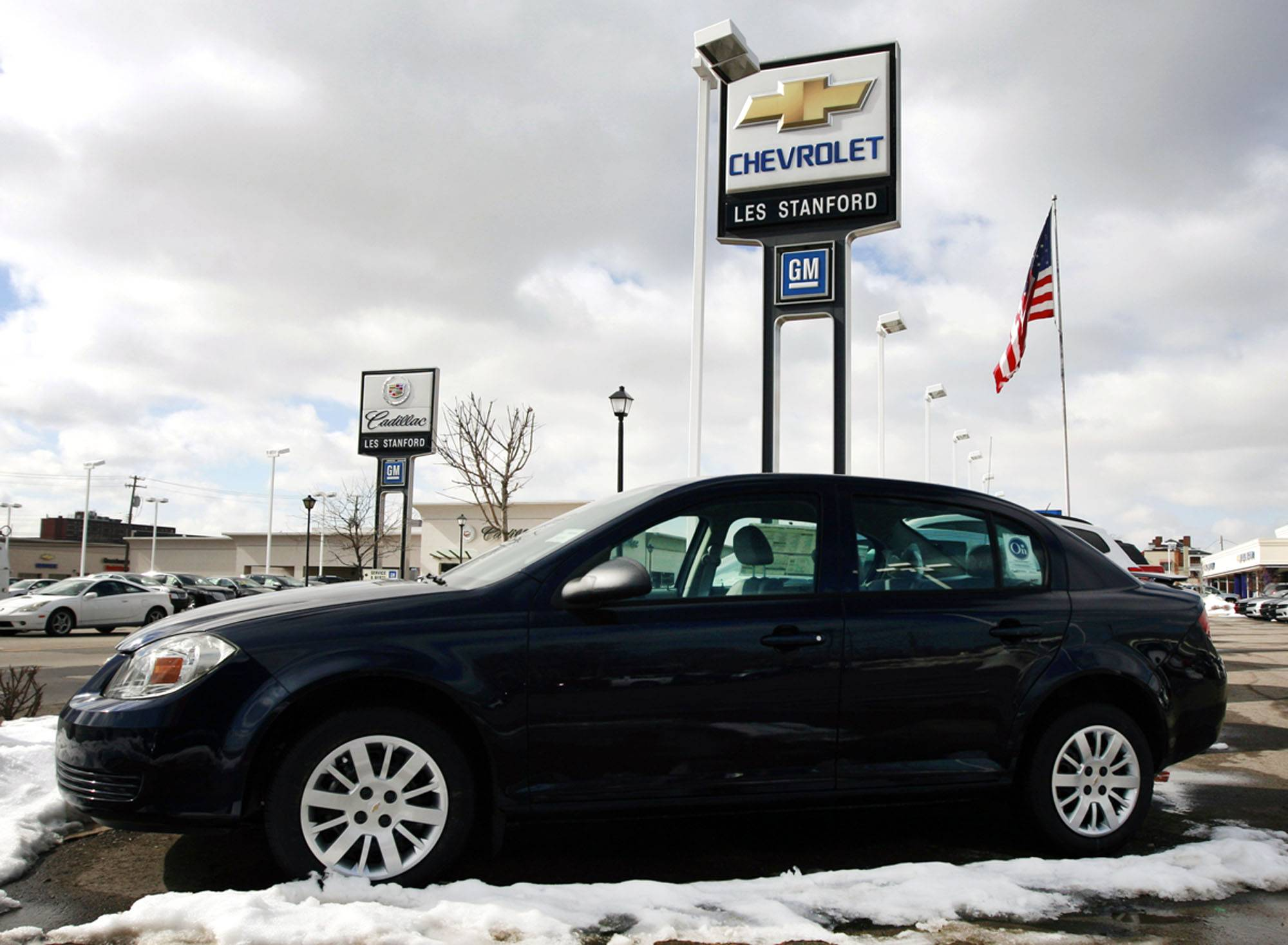 A General Motors Co. 2010 Chevrolet Cobalt sits on the lot of Les Stanford Chevrolet in Dearborn, Michigan, U.S., on Tuesday, March 2, 2010. General Motors Co. plans to recall 1.3 million Pontiac and Chevrolet vehicles in North America, including 2005-2010 Cobalts, to fix power-steering systems after U.S. regulators received more than 1,100 consumer complaints about failures. Photographer: Jeff Kowalsky/Bloomberg