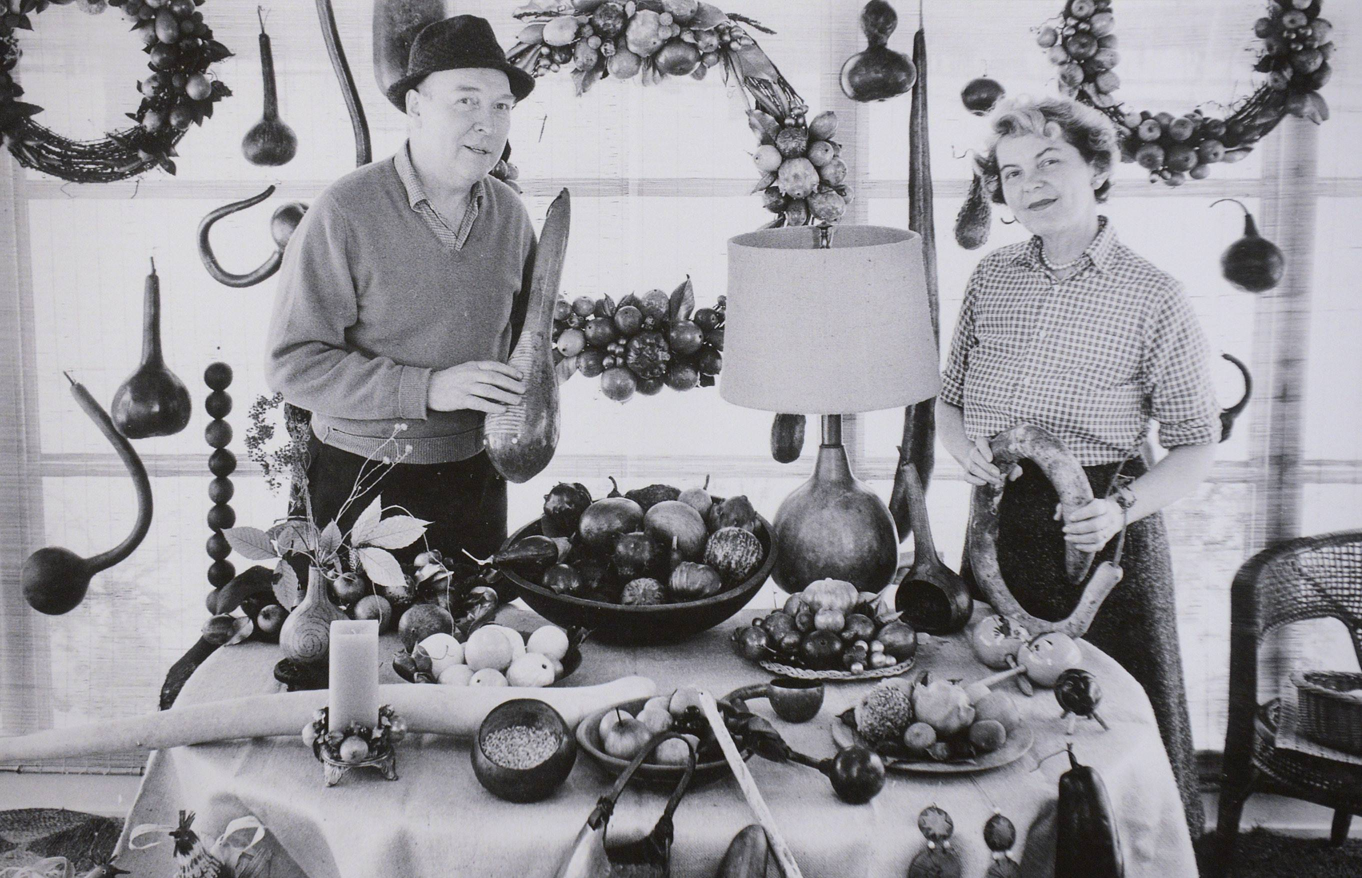 Virginia Umberger of Elgin is shown here with her late husband. Alton, and their gourd creations.