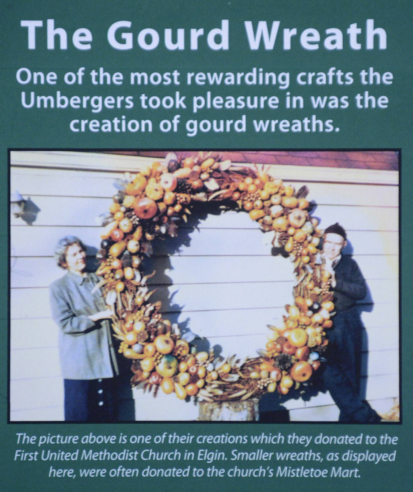 An informational display shows Virginia Umberger of Elgin and her late husband, Alton, with one of their giant gourd wreaths. Virginia, now 104, has part of her collection and gourd creations on display at the Elgin Public Museum.