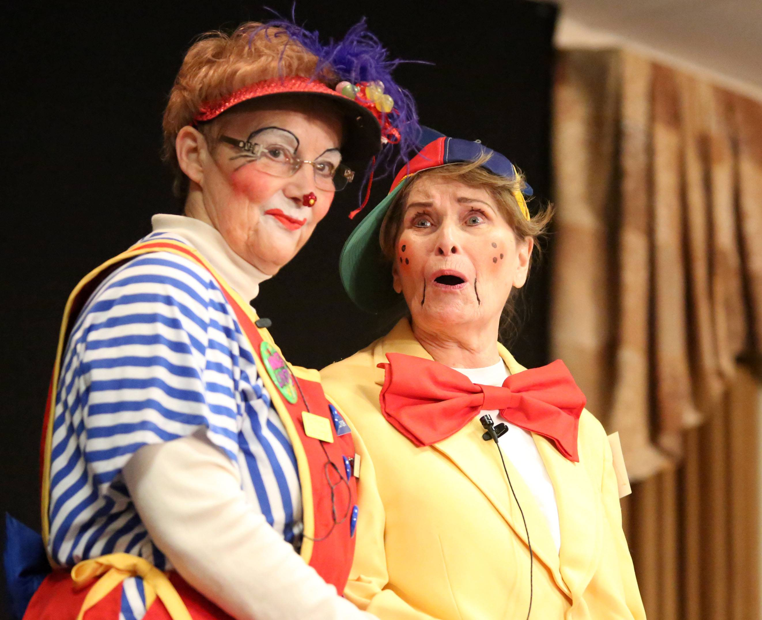 Jill Lindsay as Windy Lindy and her stage partner, Jackie Krueger, right, both of Milwaukee, perform at the World Clown Association's annual convention Thursday.