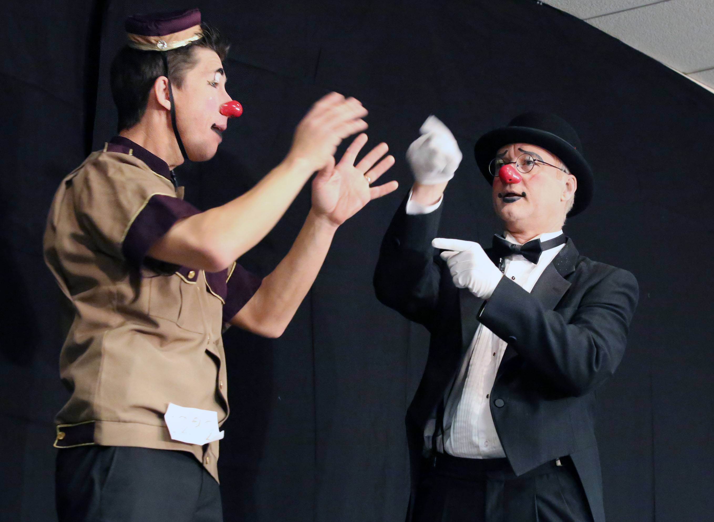 Jim Dixon from Kansas, also known as Soapy the clown, and Ken Noesgaard, right, of Canada, also known as Kenny the clown, take the stage Thursday.