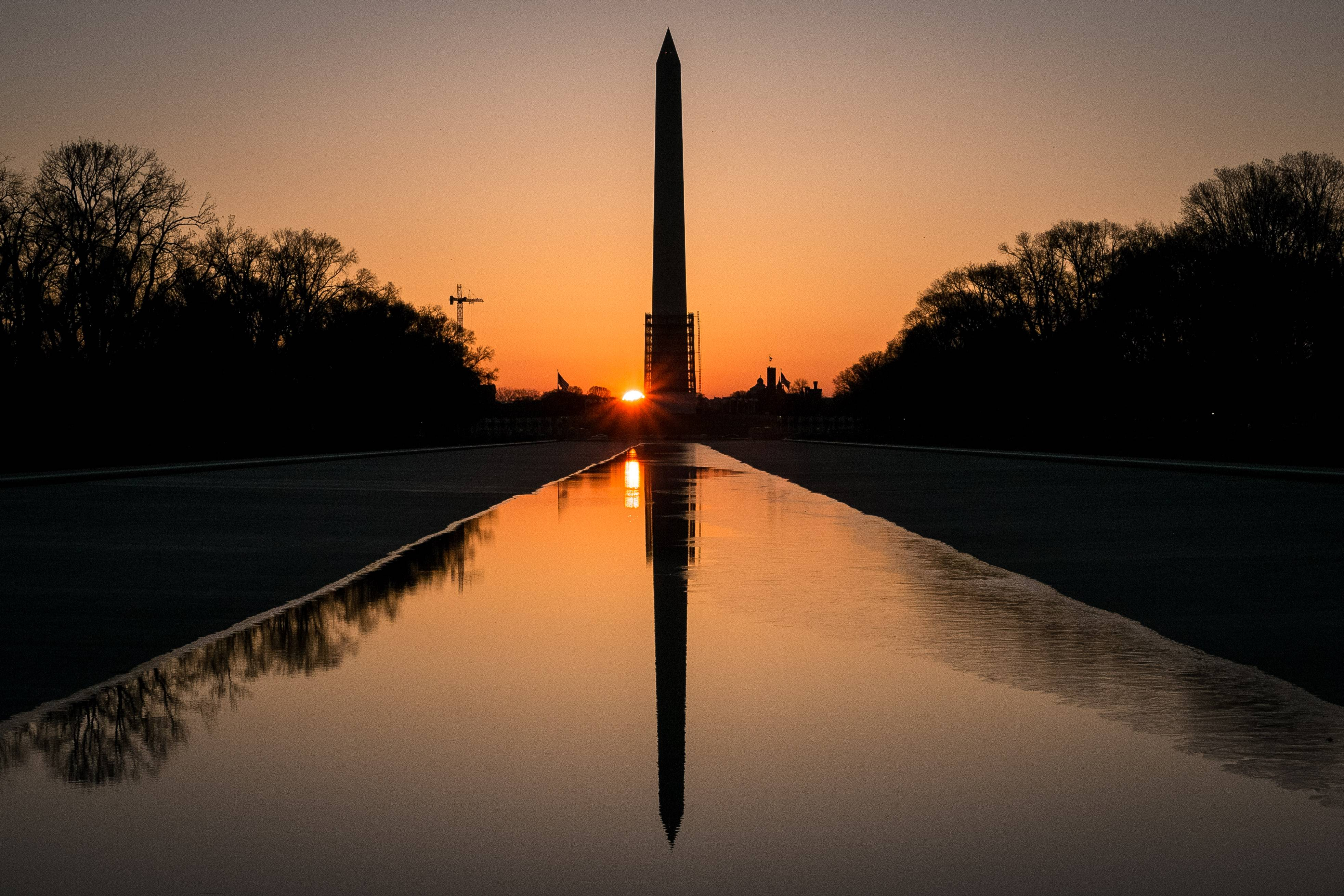 The sun peeks through the scaffolding around the Washington Monument at dawn in Washington. The National Park Service has announced they will reopen the earthquake-damaged structure May 12.