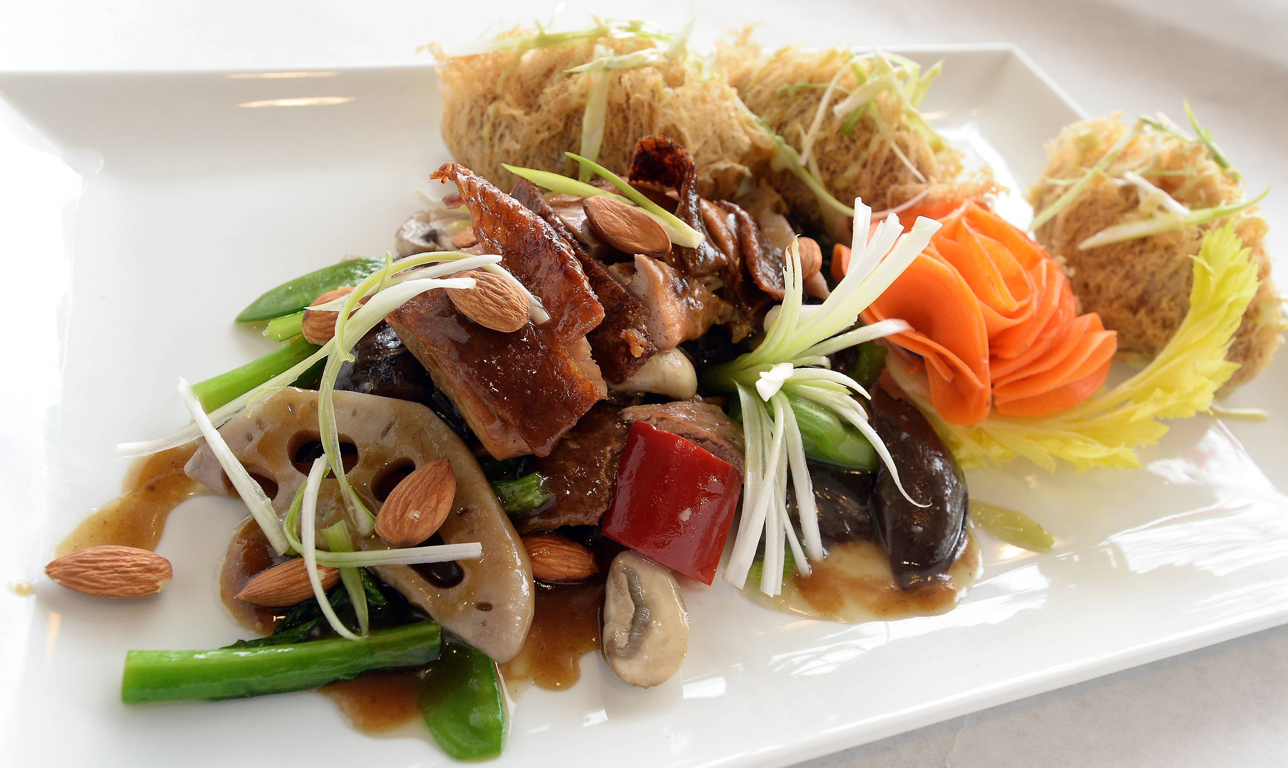 Bistro Chen's almond duck offers a nod to past long-time occupant Chin's.