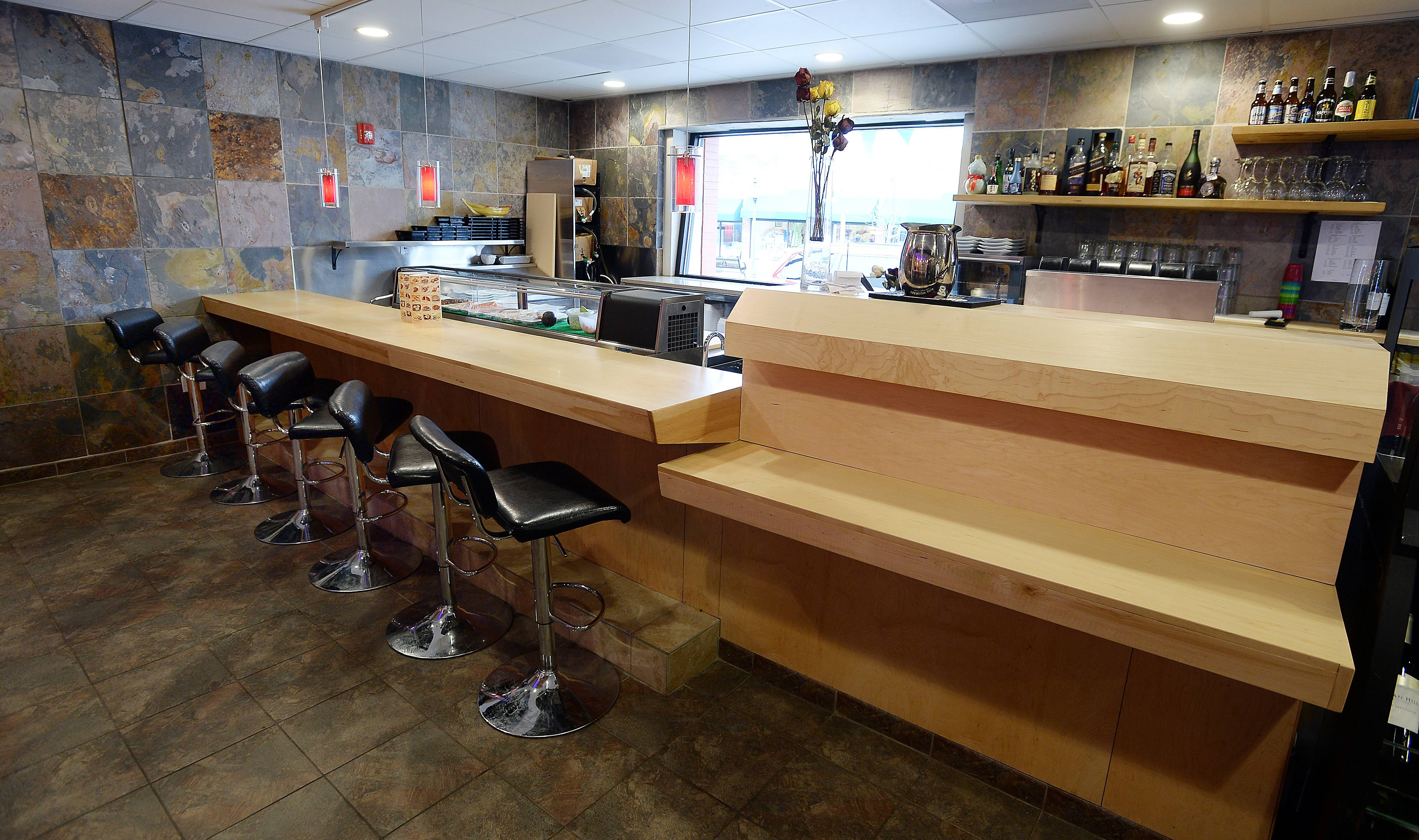 A sushi bar offers one seating option at Bistro Chen.