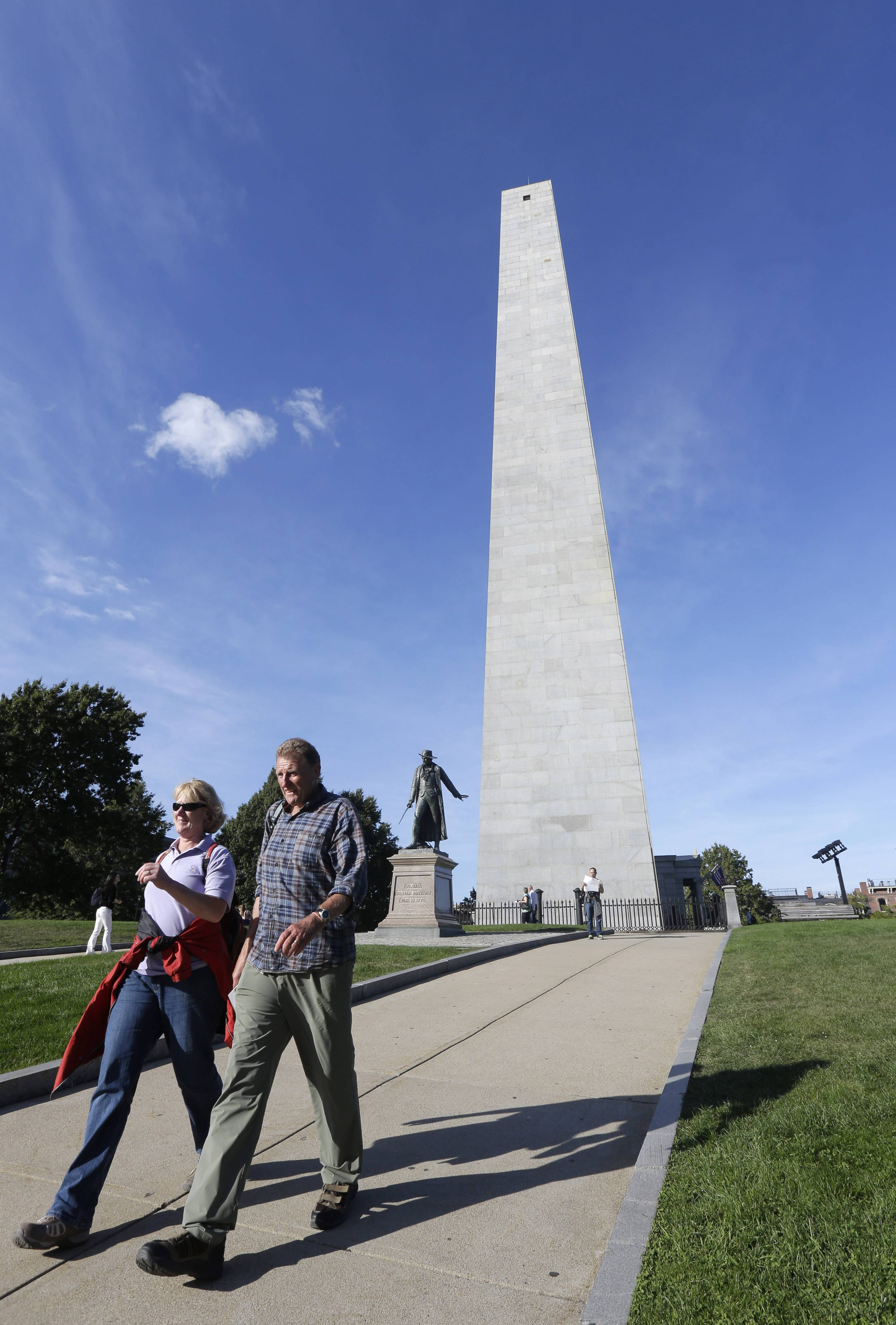Visitors stroll along a path near the Bunker Hill Monument, in the Charlestown neighborhood of Boston. The capital of Massachusetts is a vibrant modern city with a history that goes back centuries. Scattered throughout the downtown are buildings, churches and meetinghouses dating back to the American Revolution and earlier.