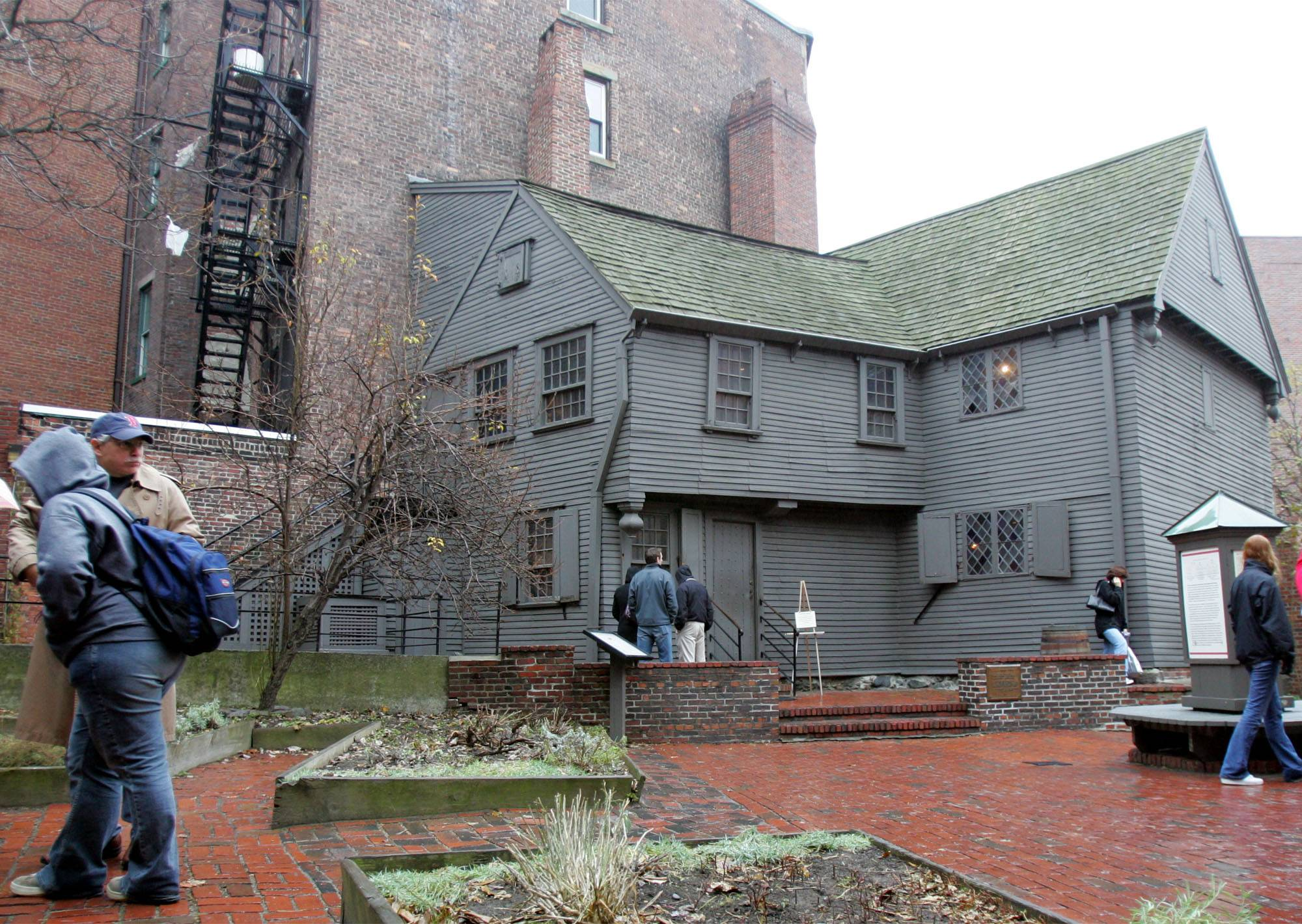 Tourists visit the Paul Revere House in the North End neighborhood of Boston. The city's most trekked tourist attraction is the 2.5-mile bricked pathway that takes visitors on a tour of Boston's past. The route starts in the heart of the city at Boston Common and winds its way over the Charles River to Charlestown to the site of the Battle of Bunker Hill. The 1680 wooden home of Paul Revere is the oldest building in downtown still in existence.