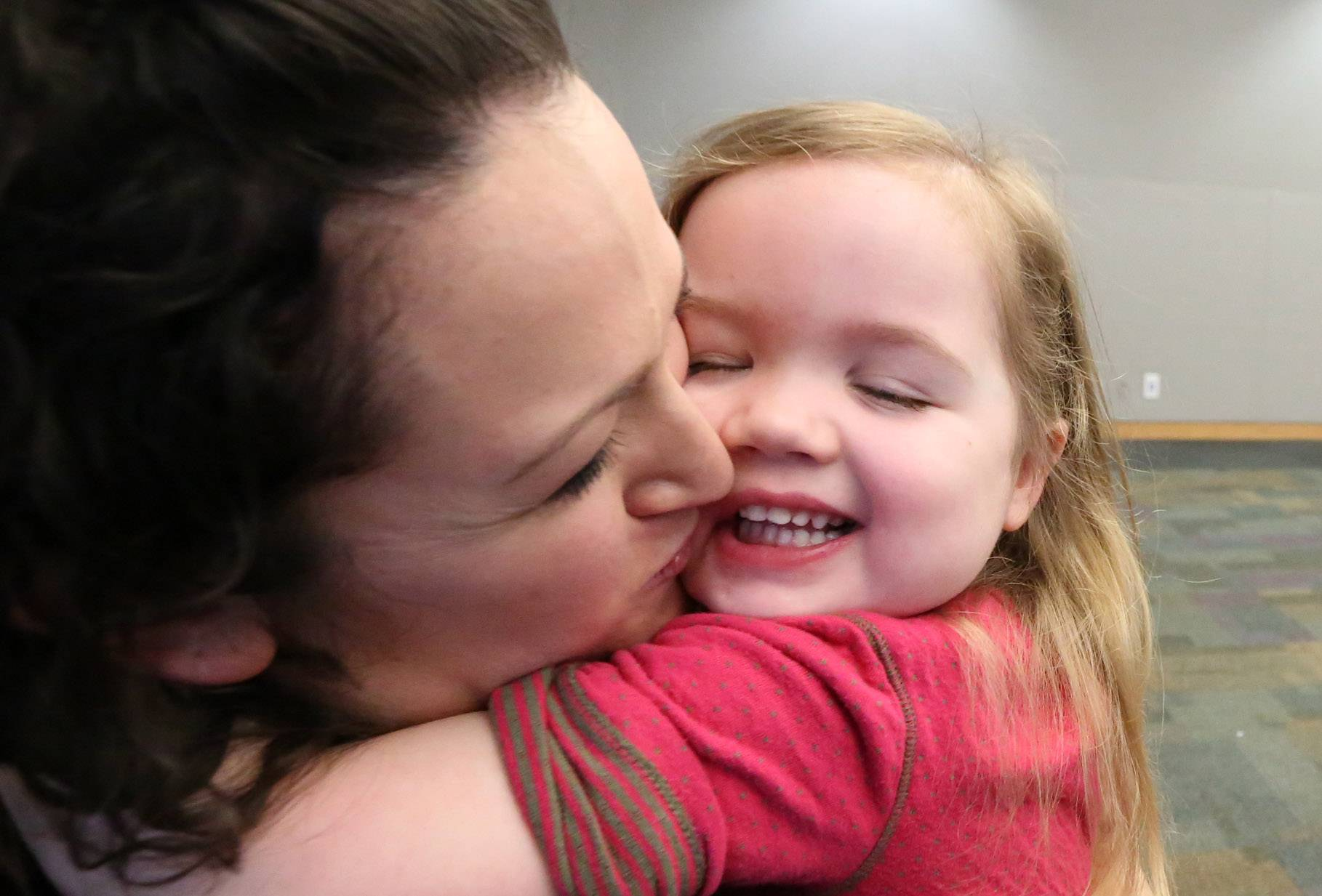 Karey Burton and her niece, Elaina Burton, 3, both of Naperville, share a hug after Karey performed with other members of the GreatWorks Touring Theatre Company at the Vernon Area Public Library on Friday in Lincolnshire.