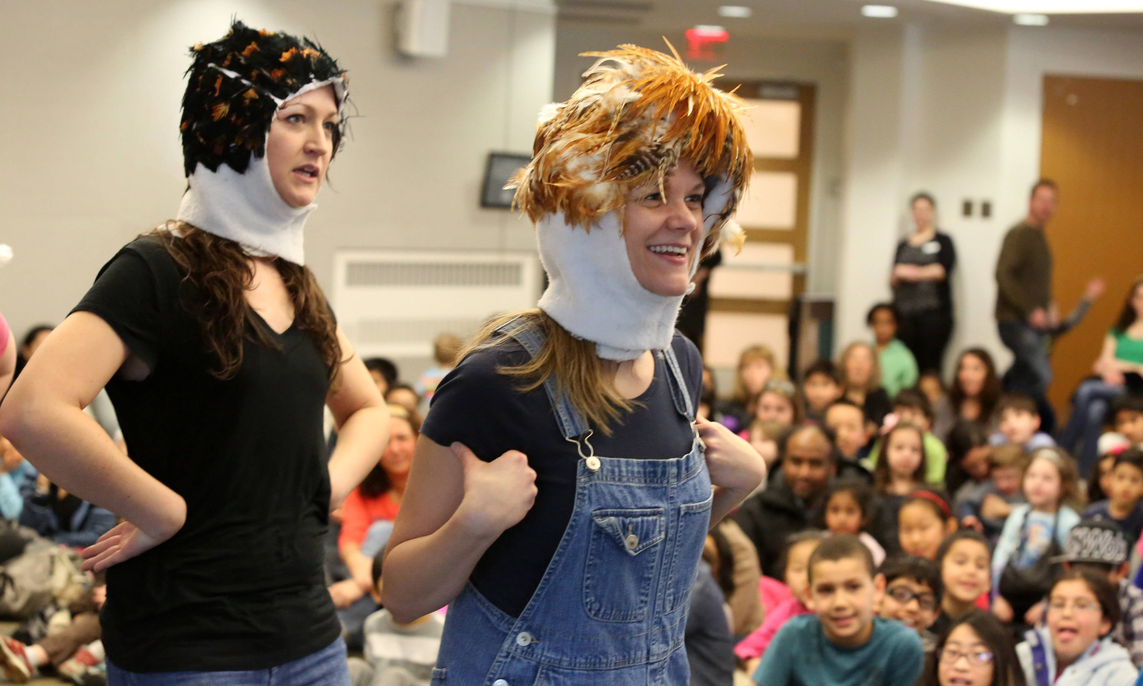 "Karey Burton of Naperville, left, and Kelly Yacono of Chicago, are chickens in Friday's performance of ""Chicken Little"" during a family spring break program called ""Fractured Fairy Tales"" at Vernon Area Public Library in Lincolnshire. Burton and Yacono are members of GreatWorks Touring Theatre Company."