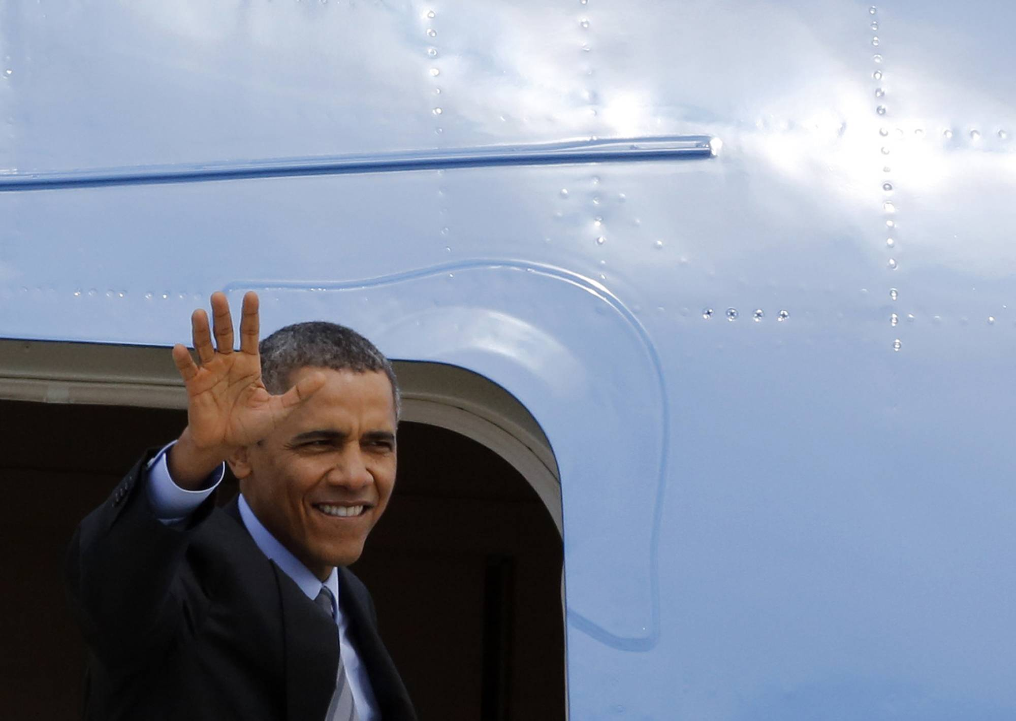 President Barack Obama waves as he boards Air Force One at Fiumicino Airport, Friday, March 28, 2014 in Rome. Obama departs Italy for Saudi Arabia, to meet with King Abdullah, the final stop on a weeklong overseas trip.