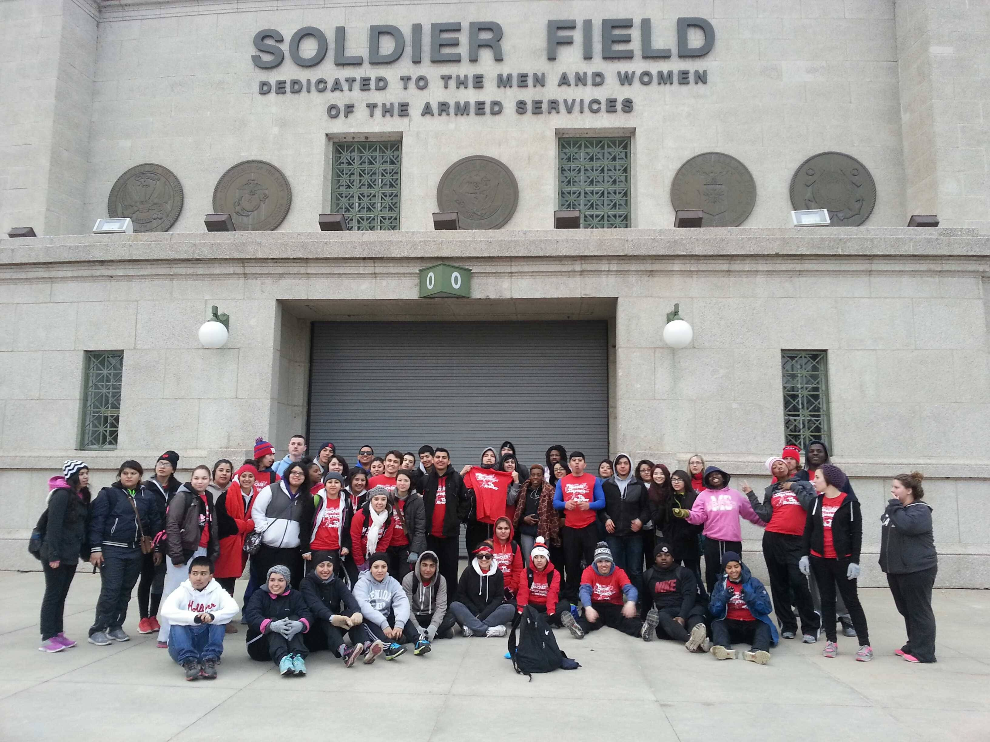 About 60 students, most of whom are in an East Aurora High School class called Survivor Literature, spent 14 hours Wednesday walking from their school to Soldier Field in Chicago to raise money to bring a former child soldier, whose book they have read, to the school to speak next month.