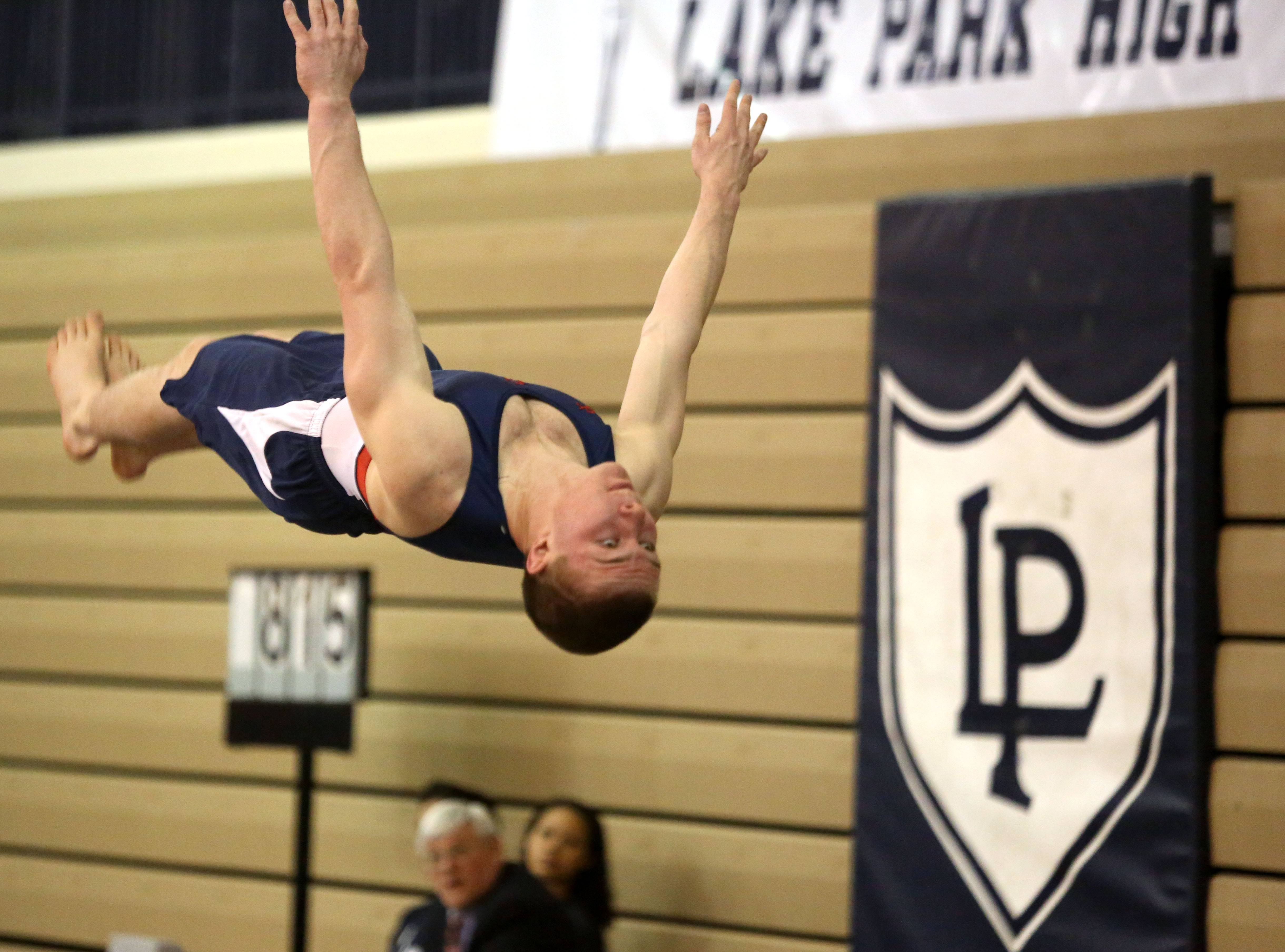 Conant's Blake Rossdeutcher performs his floor exercise routine during the Ralph Krupke Invitational at Lake Park High School.