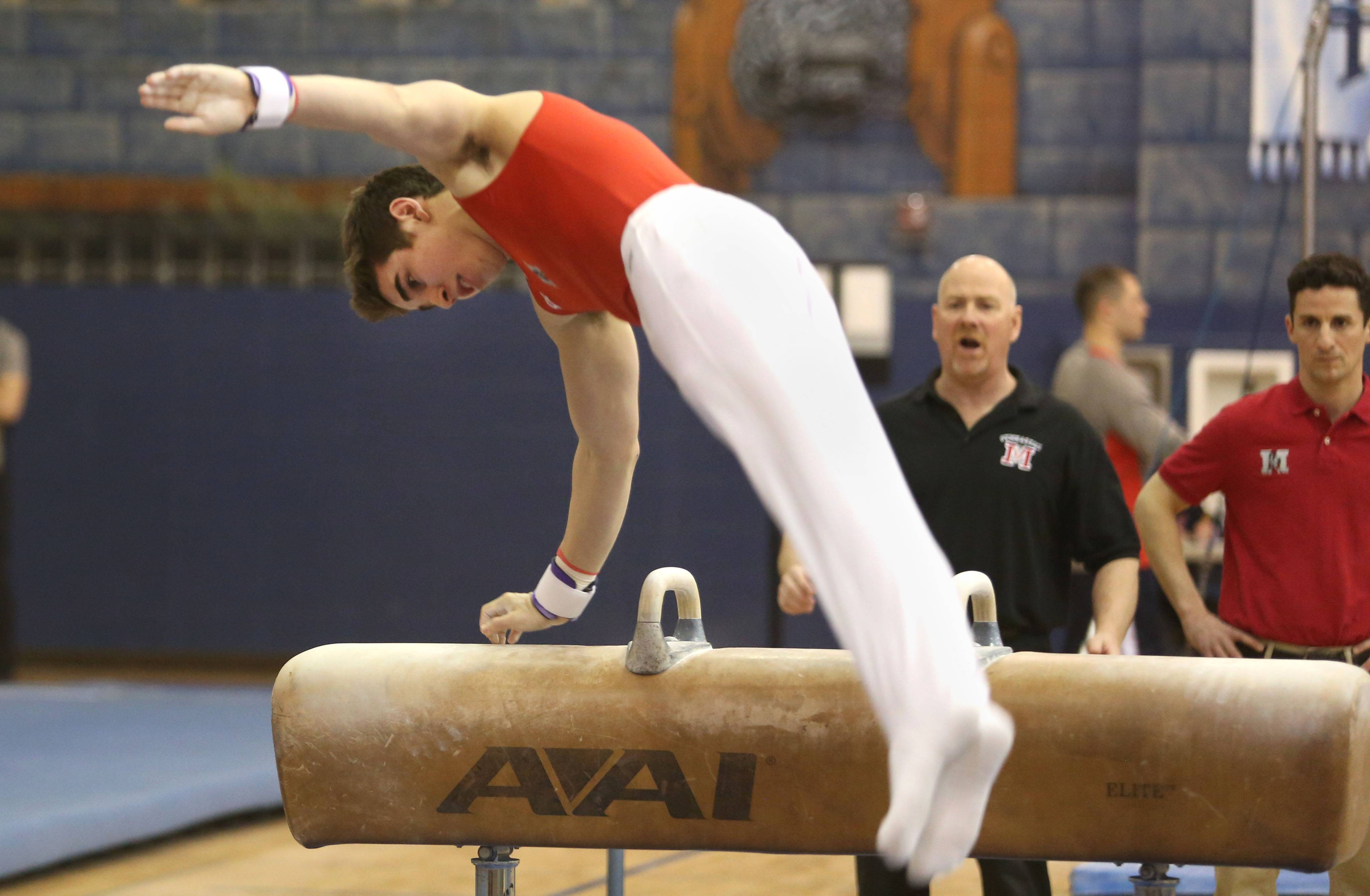 Mundelein's Colin McCarthy performs his pommel horse routine during the Ralph Krupke Invitational at Lake Park High School.