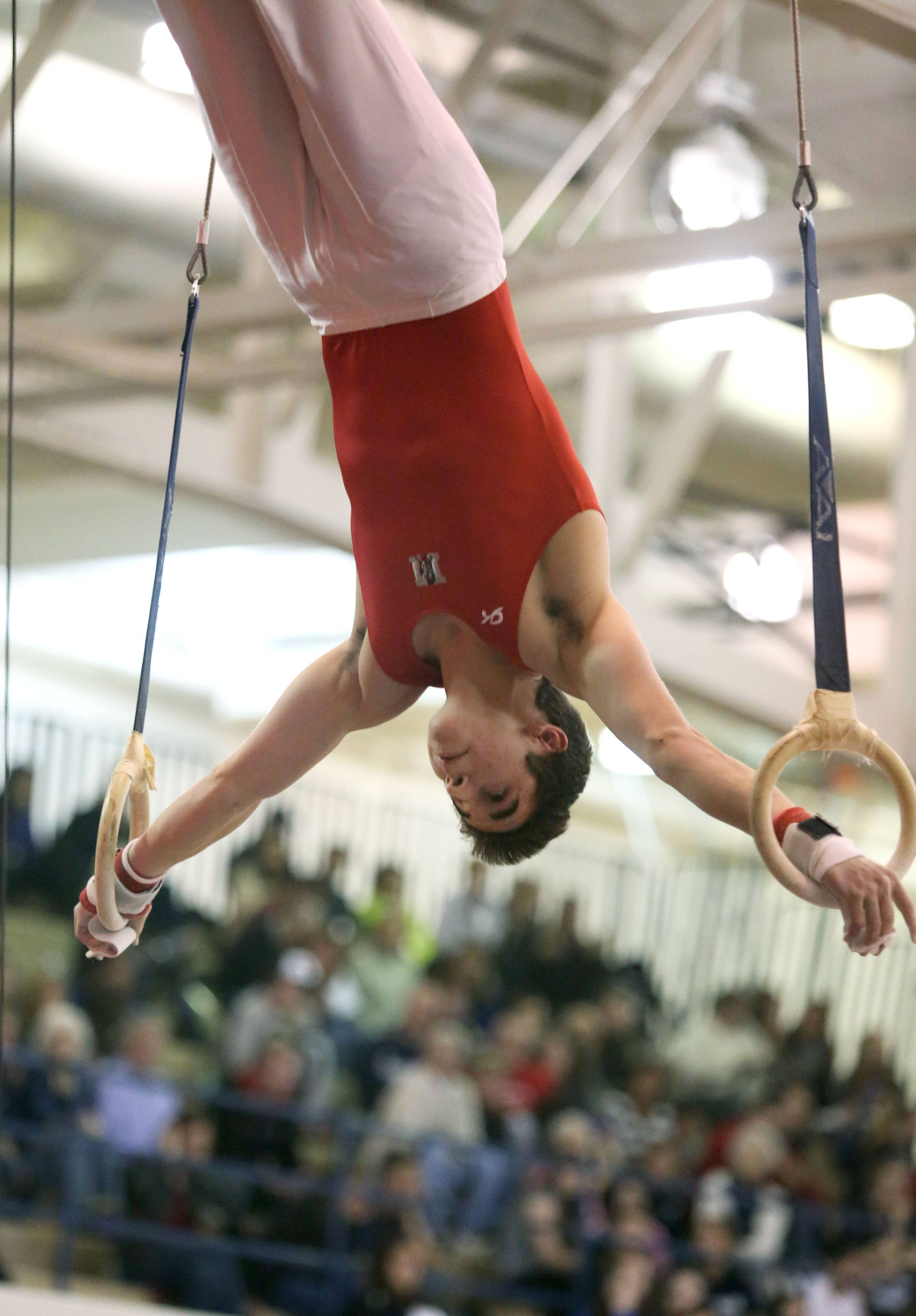 Mundelein's Colin McCarthy performs his still rings routine during the Ralph Krupke Invitational at Lake Park High School.