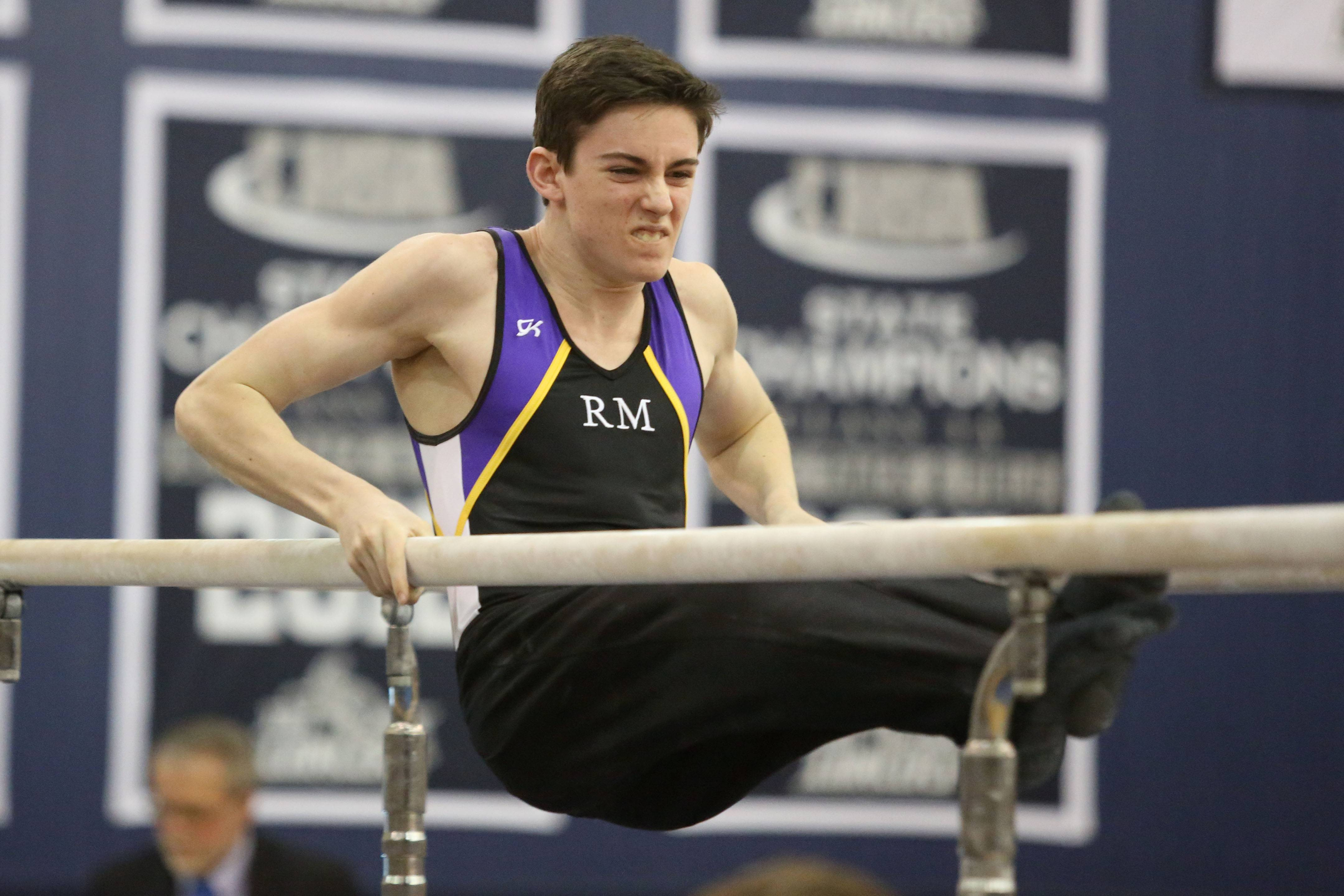 Rolling Meadows' Conor Thomas performs his parallel bar routine during the Ralph Krupke Invitational at Lake Park High School.