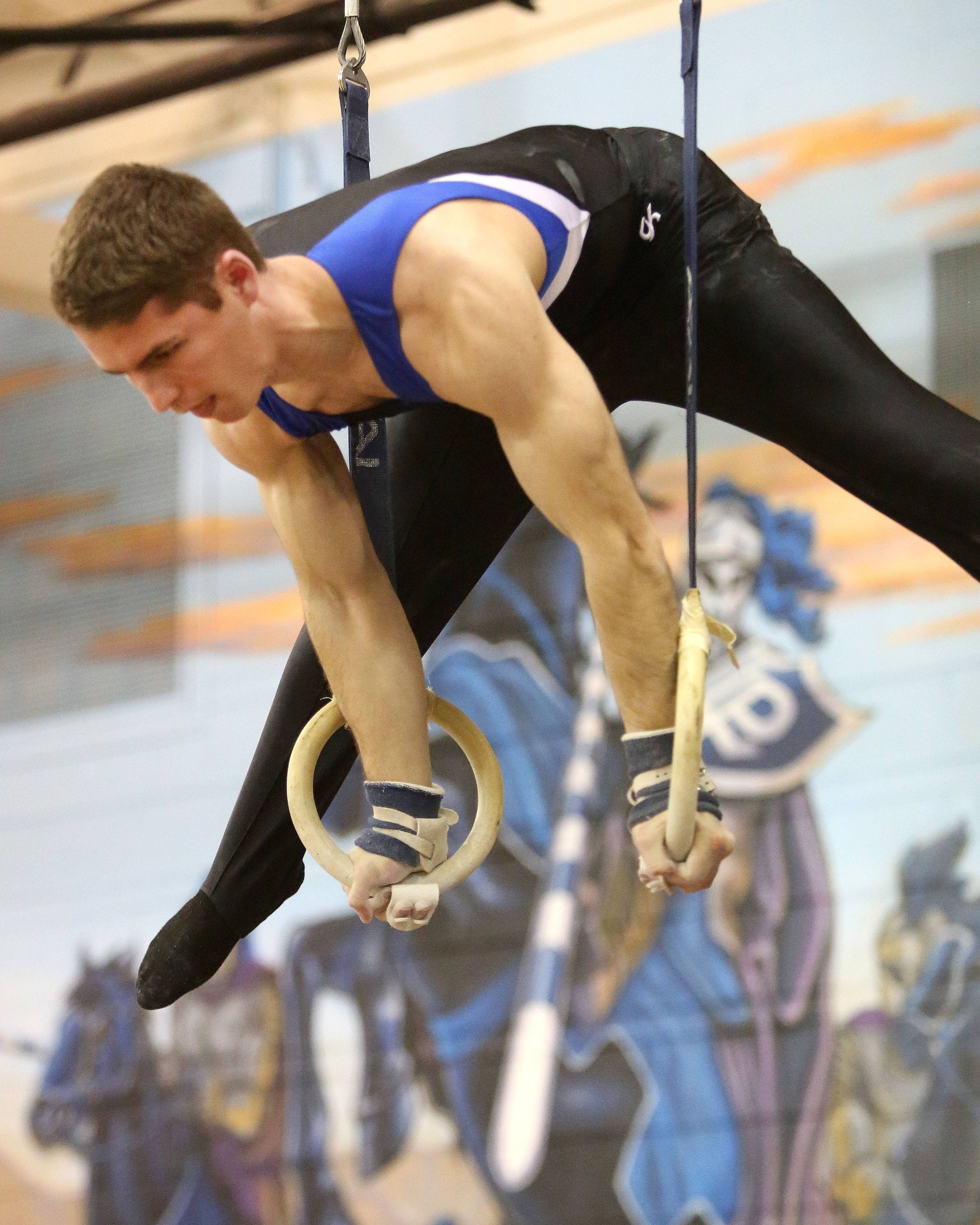Wheaton co-ops's David McDonald performs his still rings routine during the Ralph Krupke Invitational at Lake Park High School.