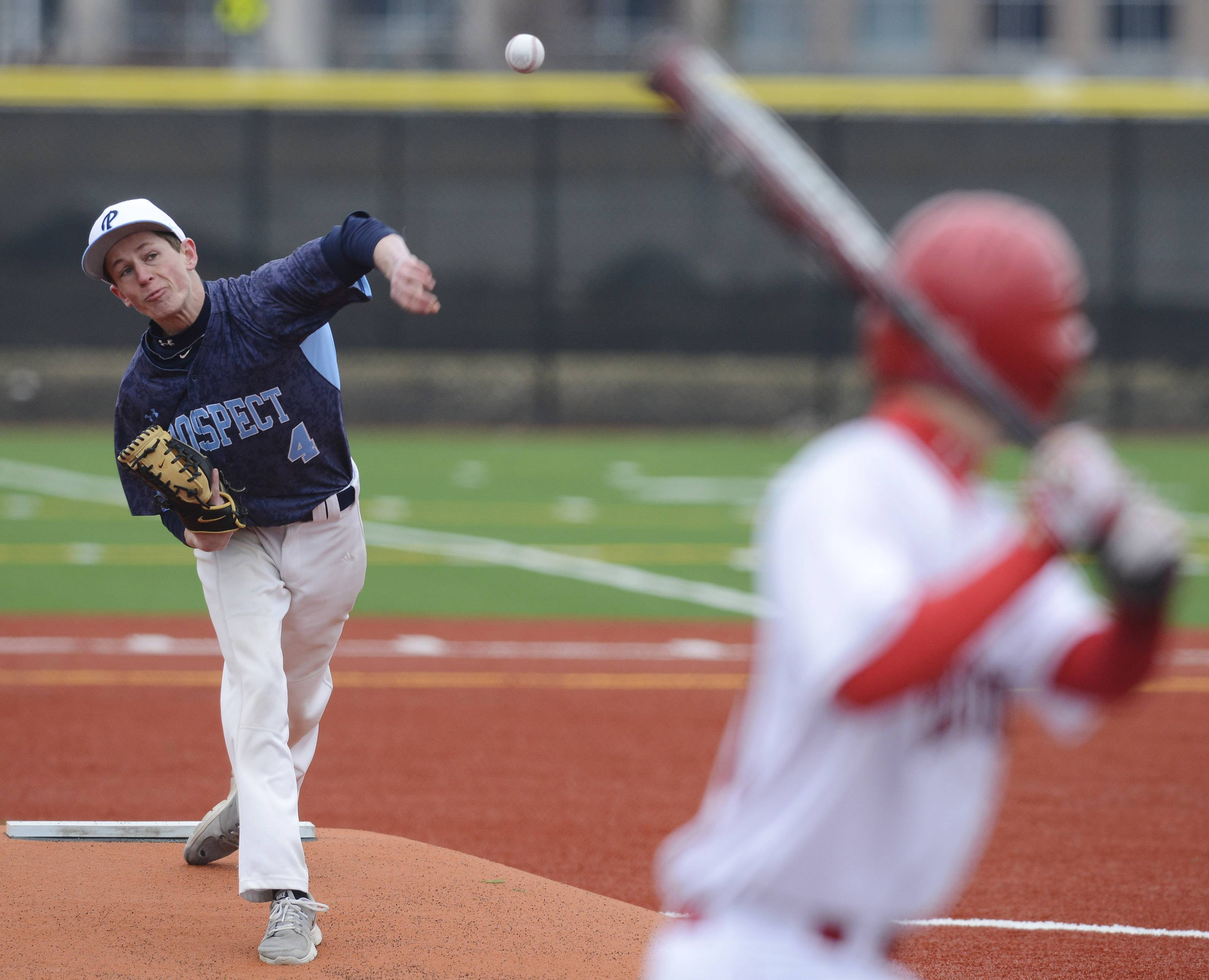 Prospect starter Mike Smith delivers against Hinsdale Central at Heritage Park in Wheeling on Friday.